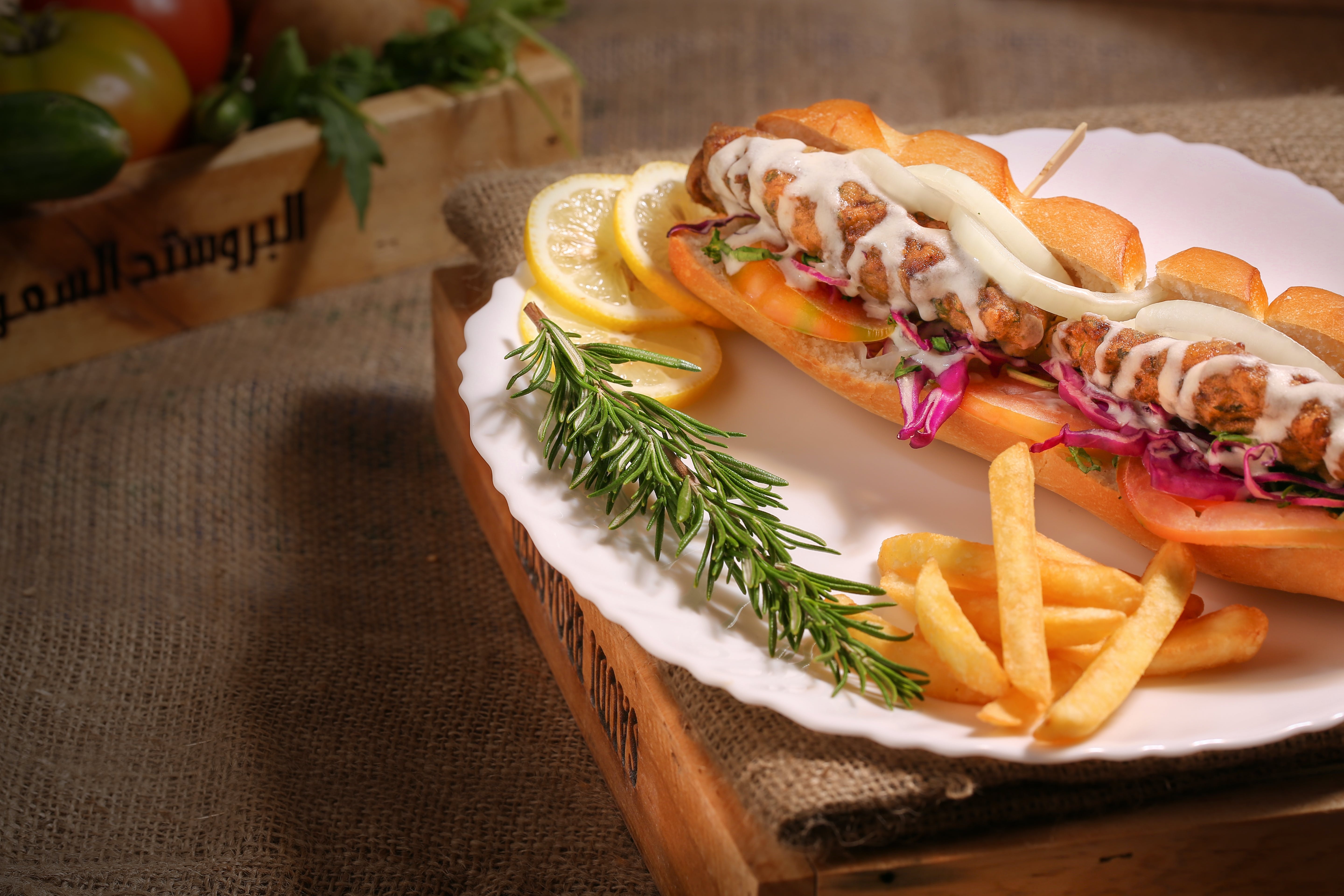Bread, Fries, And Sliced Lemon Served On White Plate