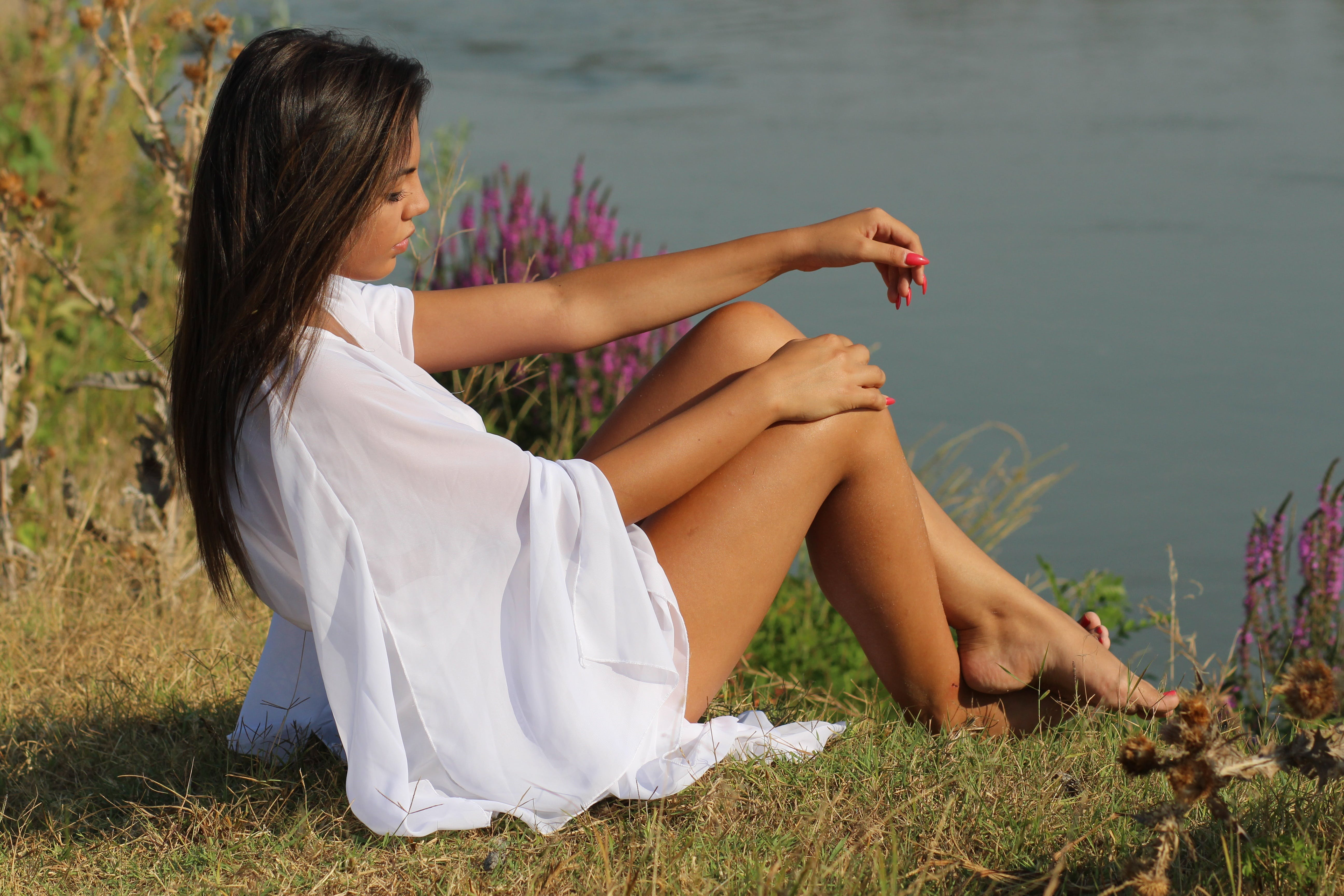 Woman in White Dress Sitting Beside River