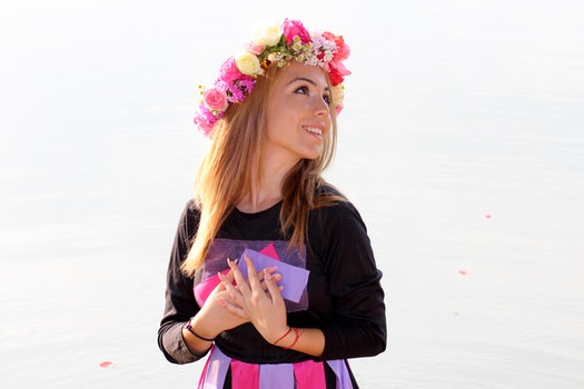 Woman in Black Purple and Pink Long Sleeve Dress and Pink Yellow and Beige Rose Headdress