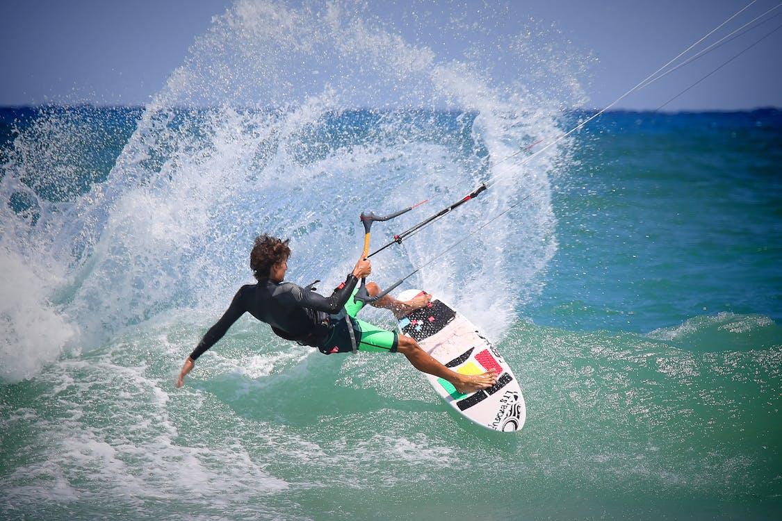 Person Riding Surf Board