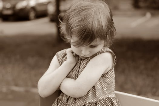 Sepia Photography of Girl in Polka Dot Dress