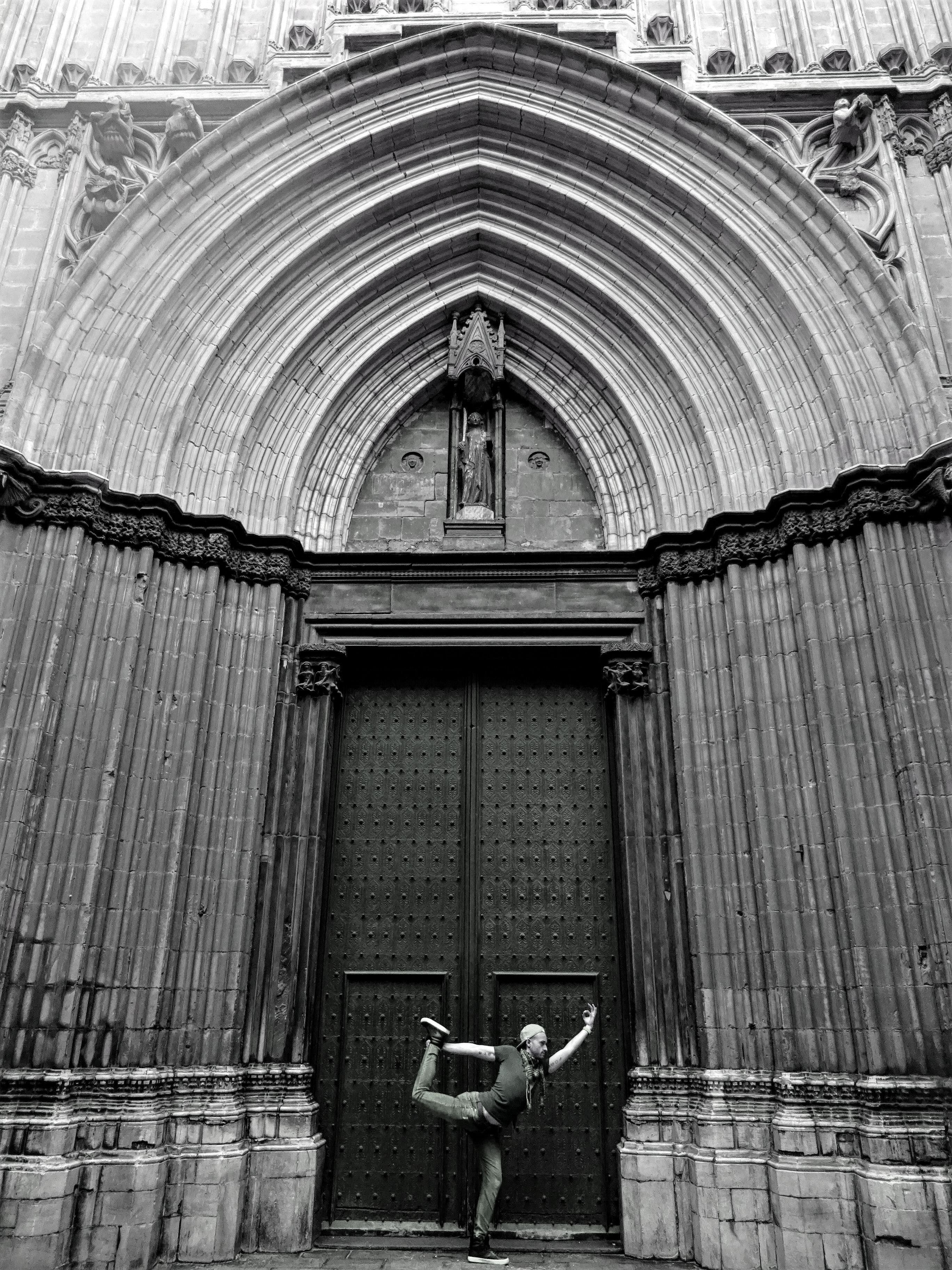 Grayscale Photography of Person Standing Near Door
