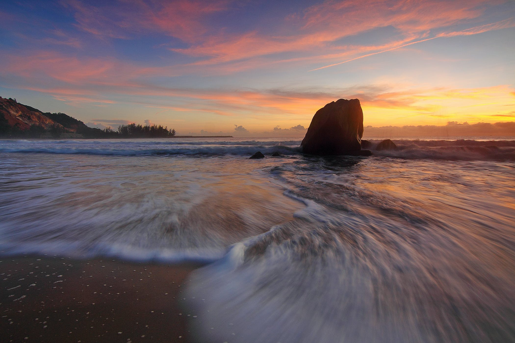 Time-lapse Photography of Waves Rushed to Shore during Golden Hour