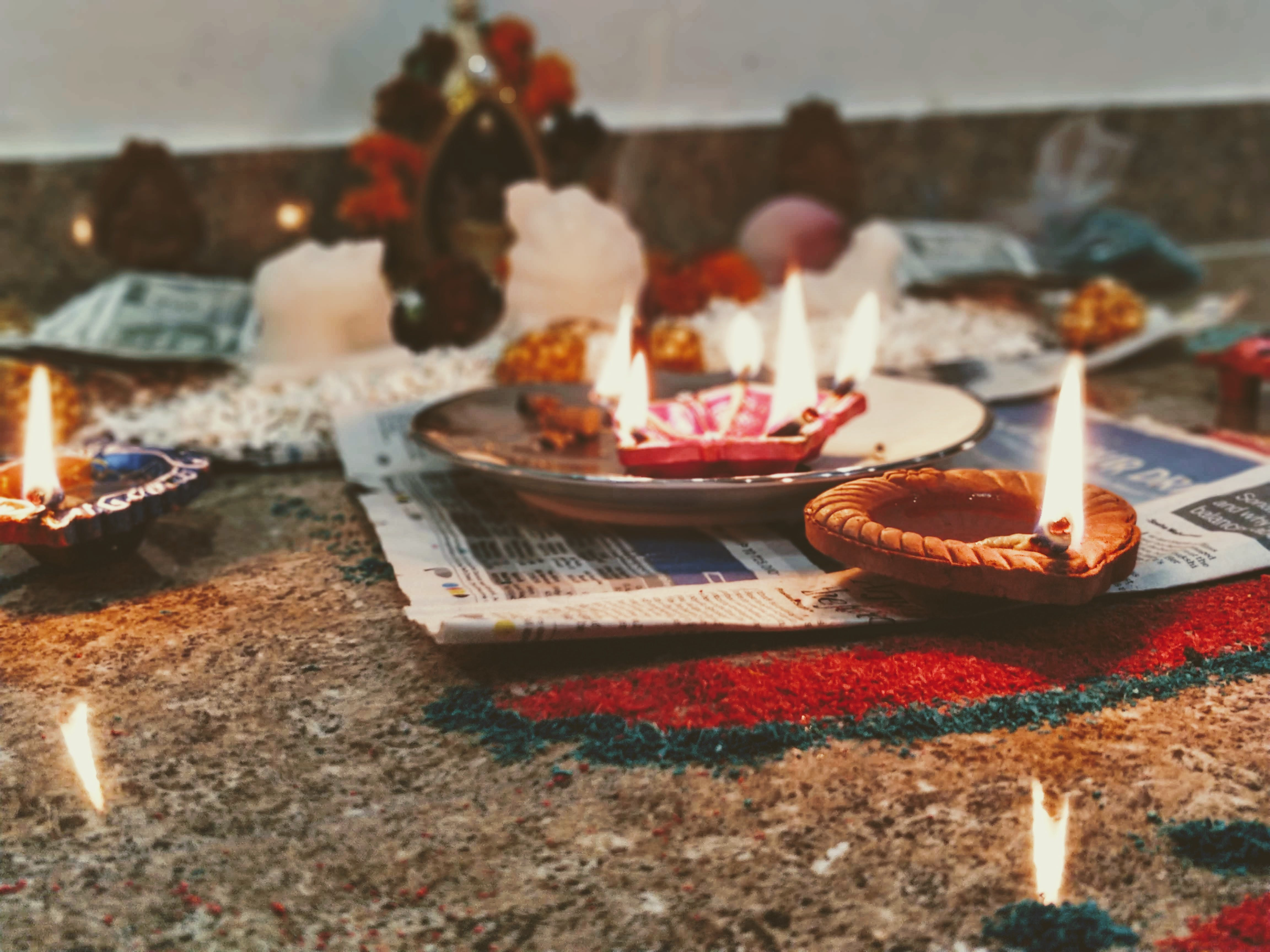 Brown Votive Candle on Newspaper