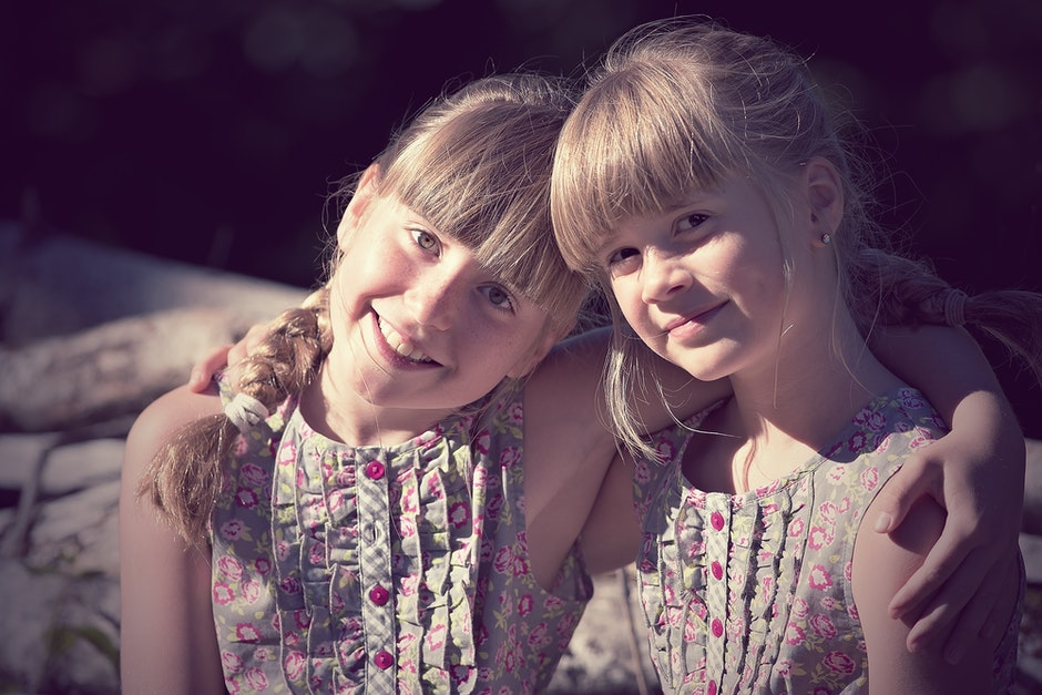 2 Girl on Grey and Pink Dress on Daytime