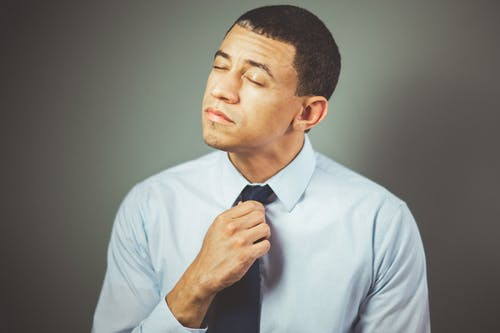 Man Arranging His Black Necktie