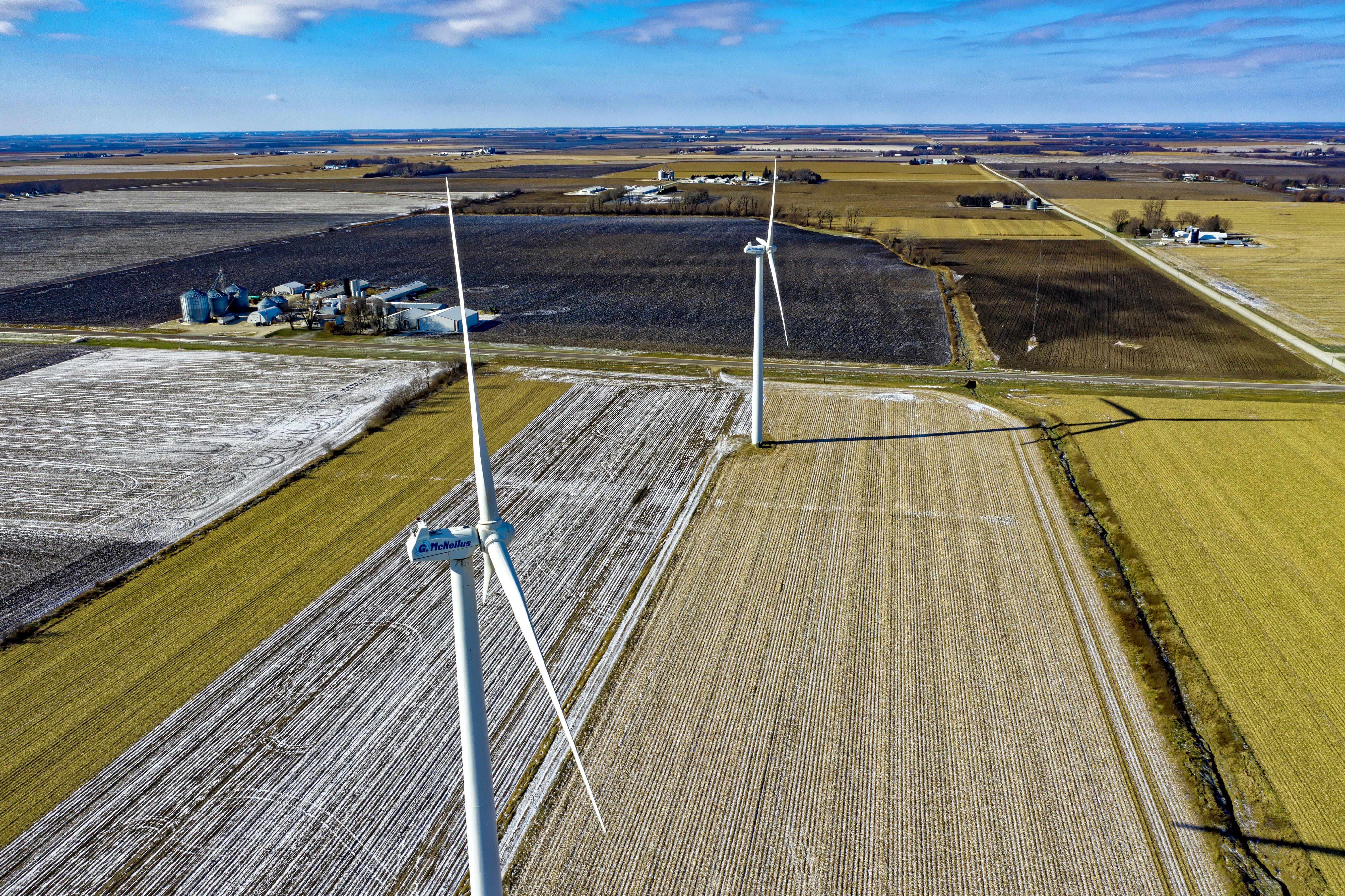 Windmills And Green Grass Field