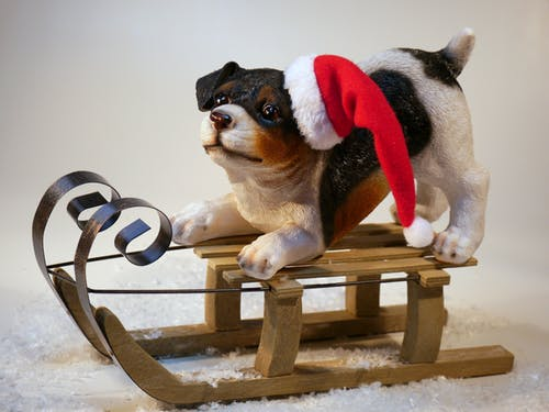 Dog on Wooden Sled Figure