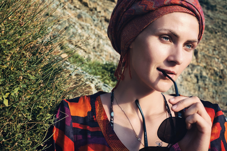 Portrait of Woman Holding Black Sunglasses