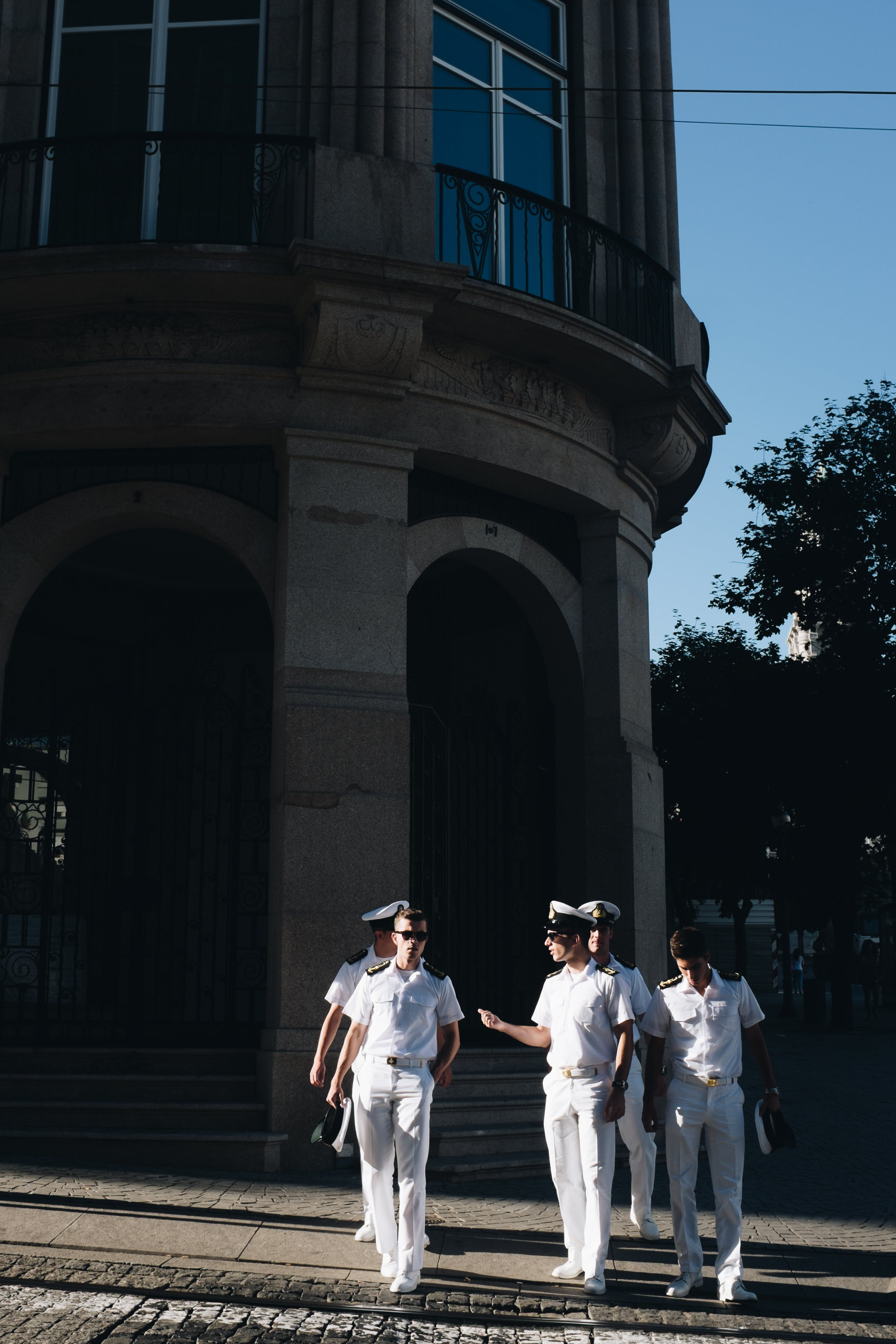 Five Navy Officers Standing Near Building