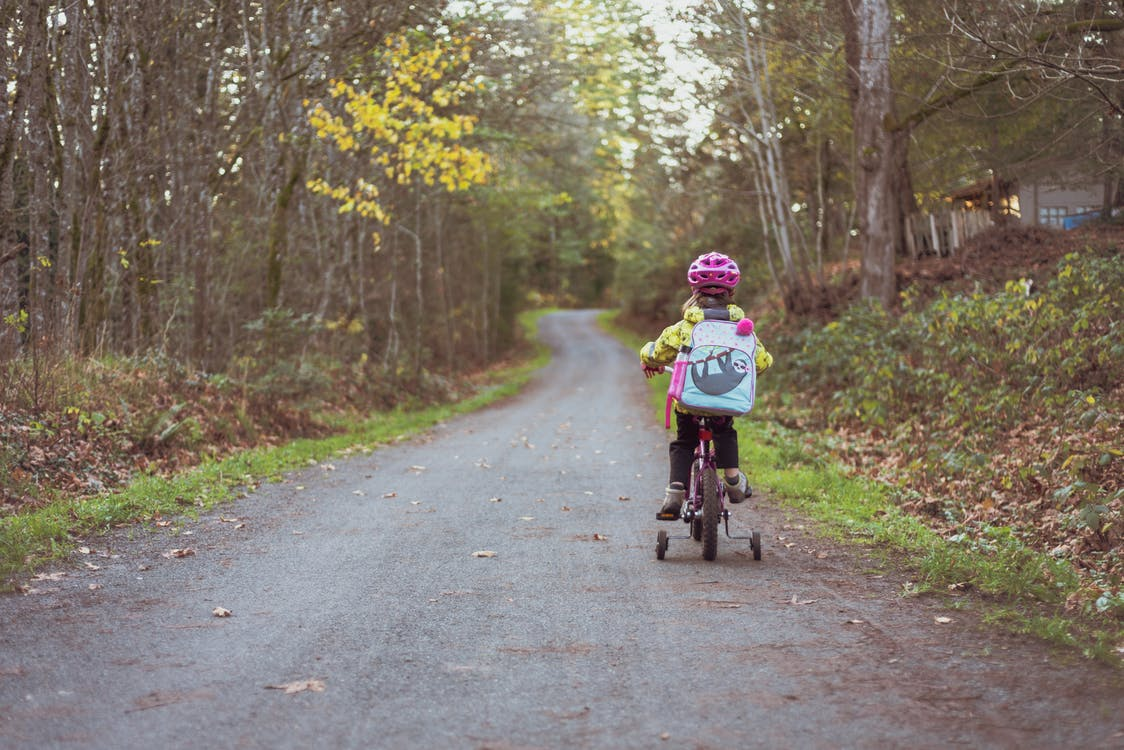 Toddler Riding Bicycle on Road