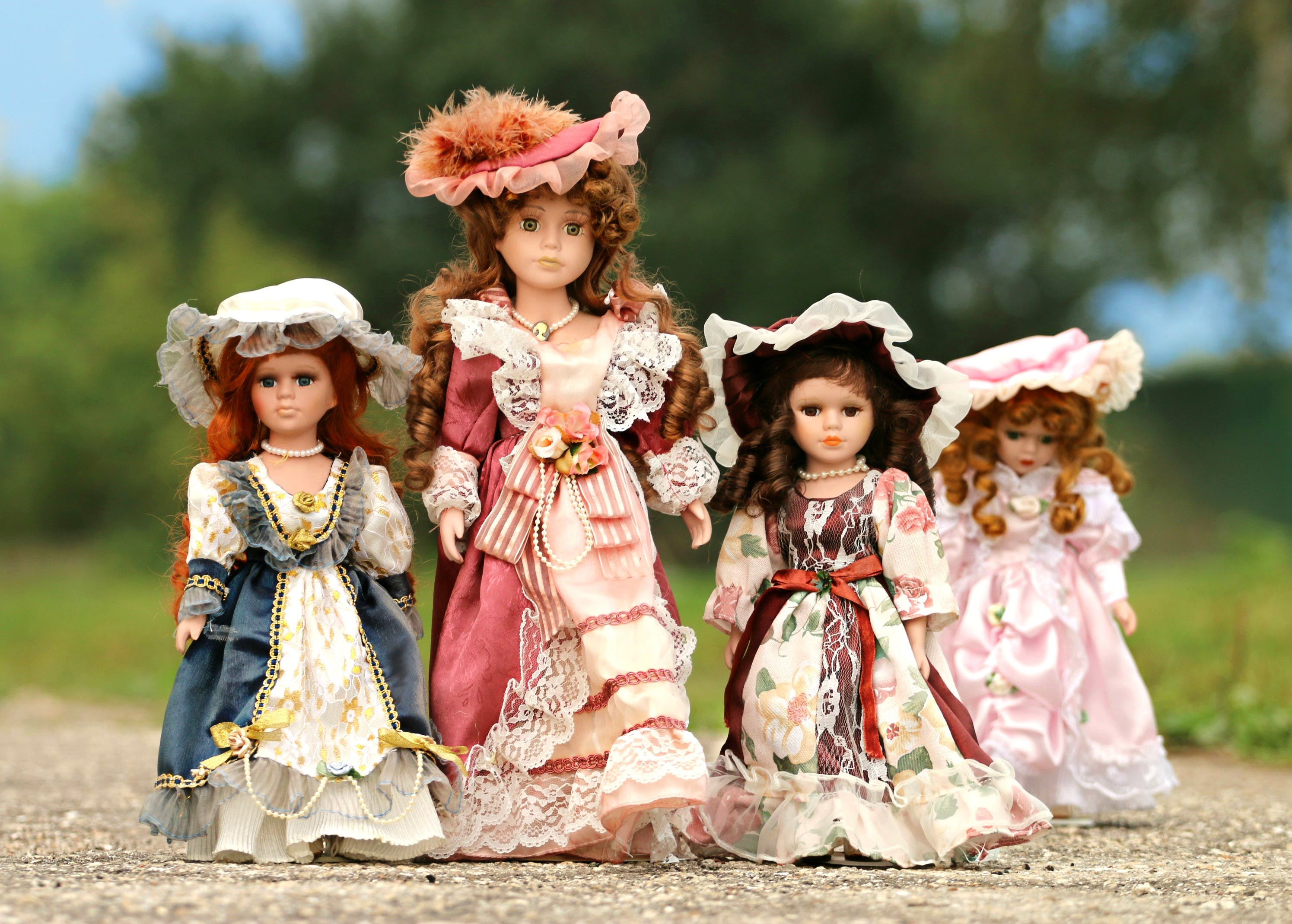 Red and White Dressed Porcelain Doll