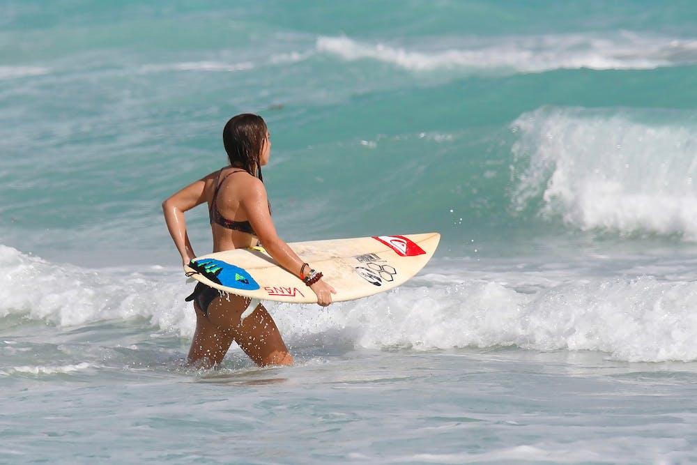 Teennaked beaches young girl surfer quinn