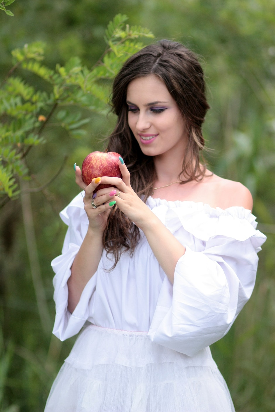 Woman Wearing White Off Shoulder Top Holding Red Apple Fruit