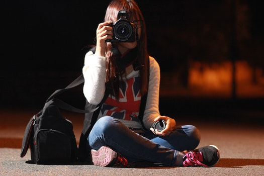 Woman in White Long Sleeve Shirt Taking Picture during Nightie