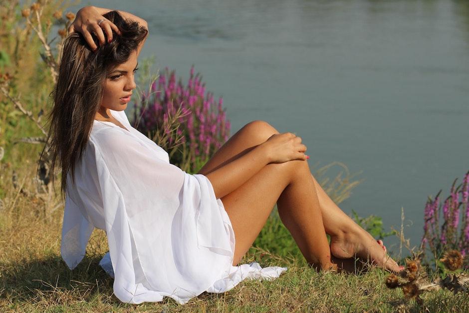 Woman Wearing White Bat Wing Top Posing Near River during Daytime