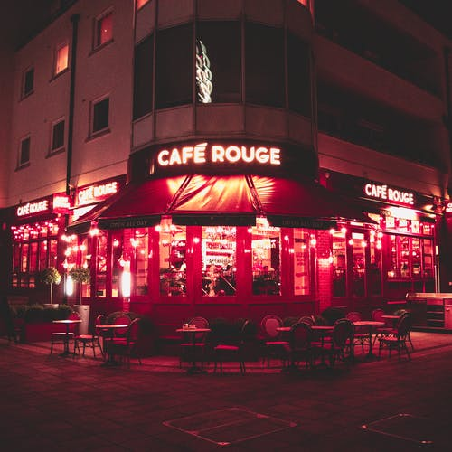 Gray Building With Cafe Rouge Led Signage