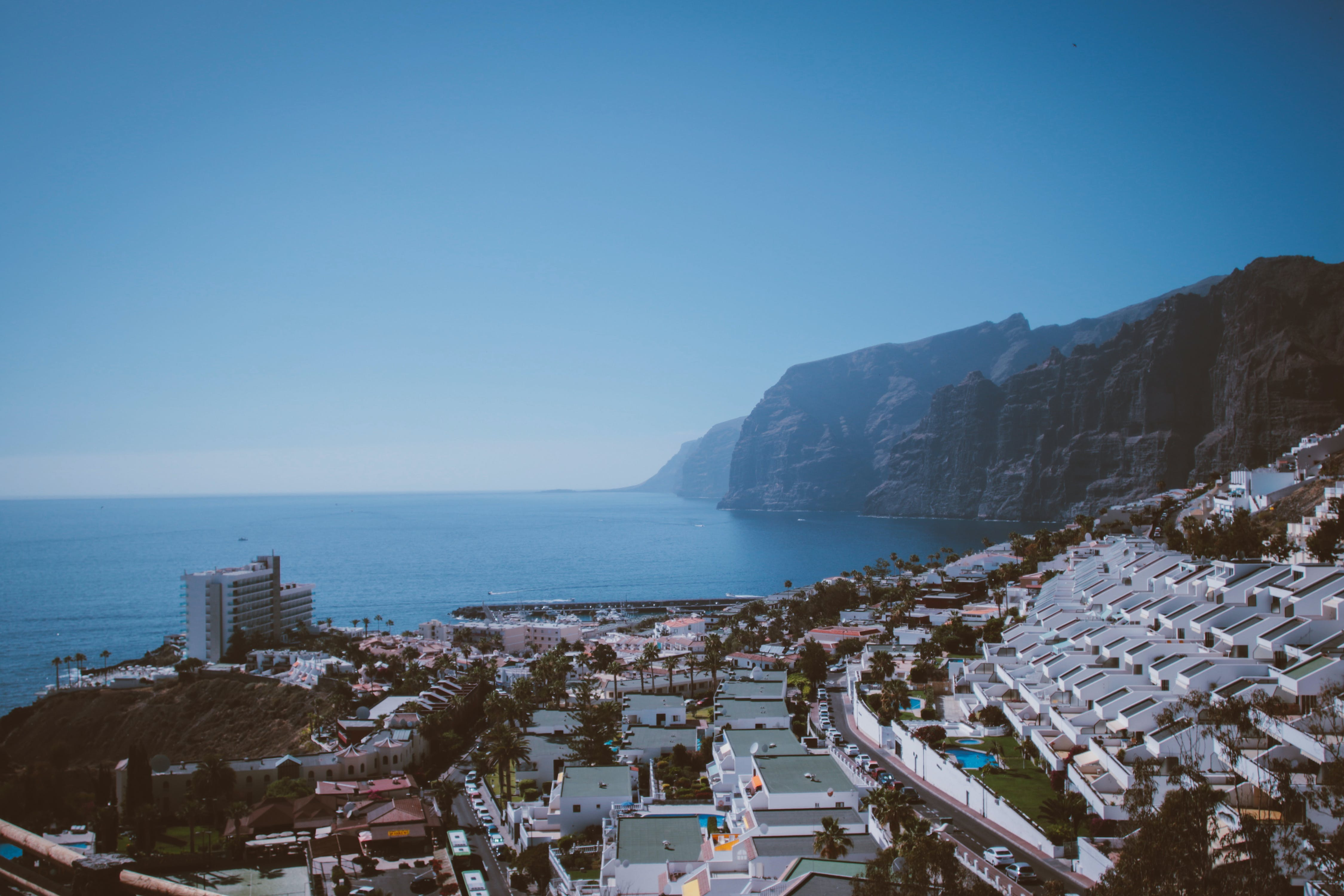 High-angle Photography of Building Beside Seashore