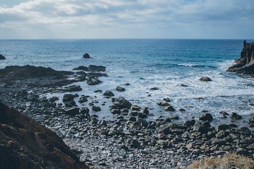 Photos gratuites de bord de mer, cailloux, eau, mer