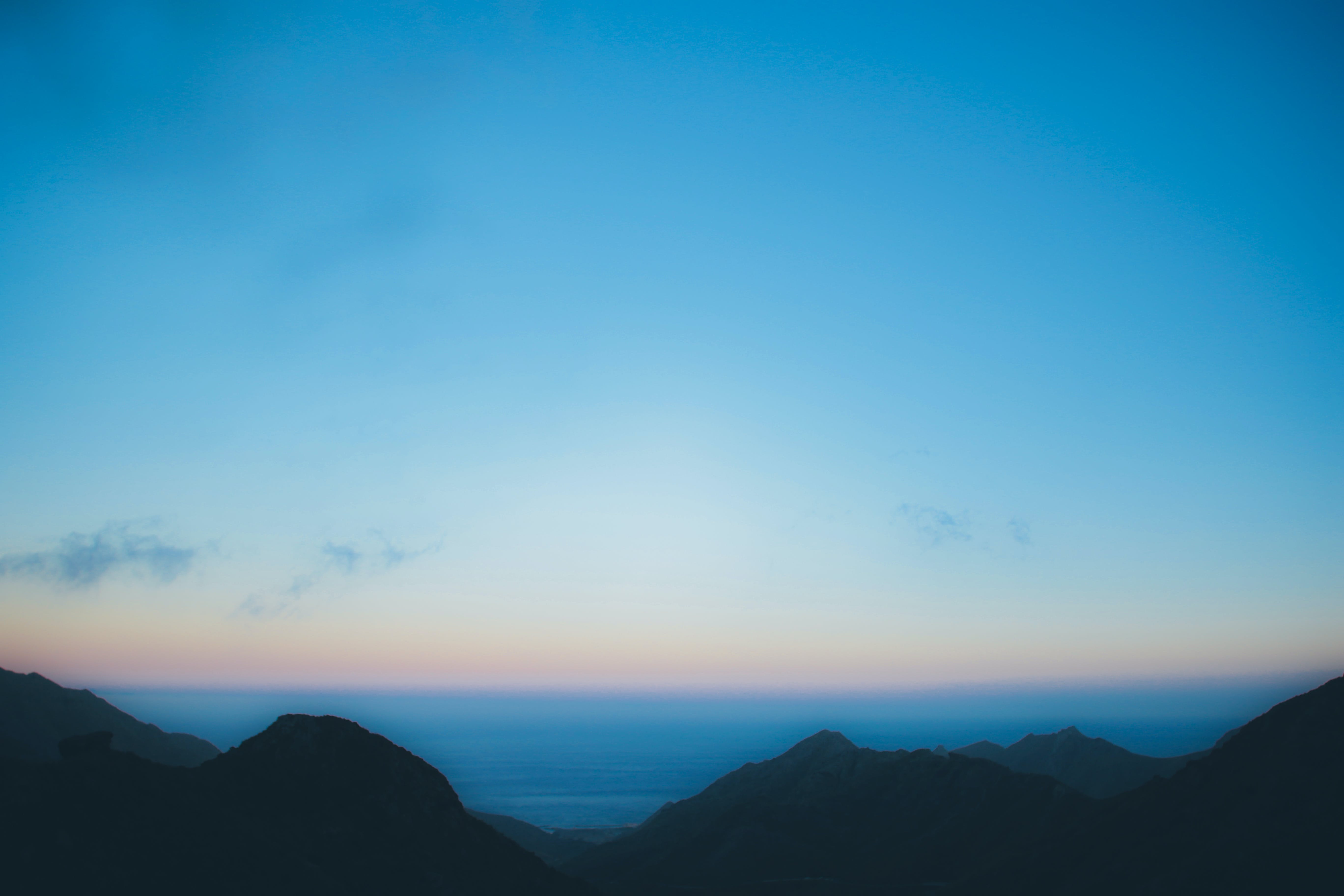 Silhouette Of Mountain Under Blue Sky