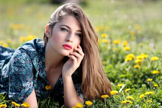 Free stock photos of beautiful girl pexels girl lying on yellow flower field during daytime voltagebd Gallery