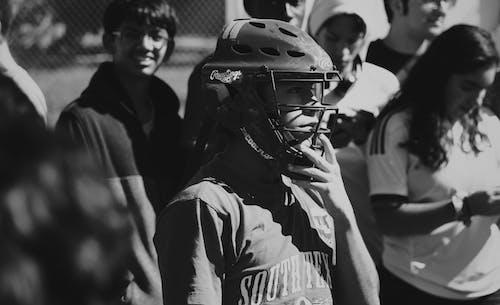 Grayscale Photo of Man Wearing Helmet