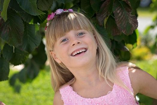 Girl Wearing Pink Floral Tank Dress Smiling