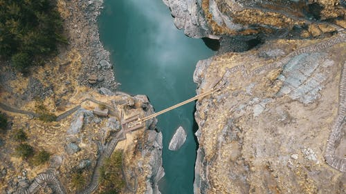 Aerial Photography of Cliff With Bridge
