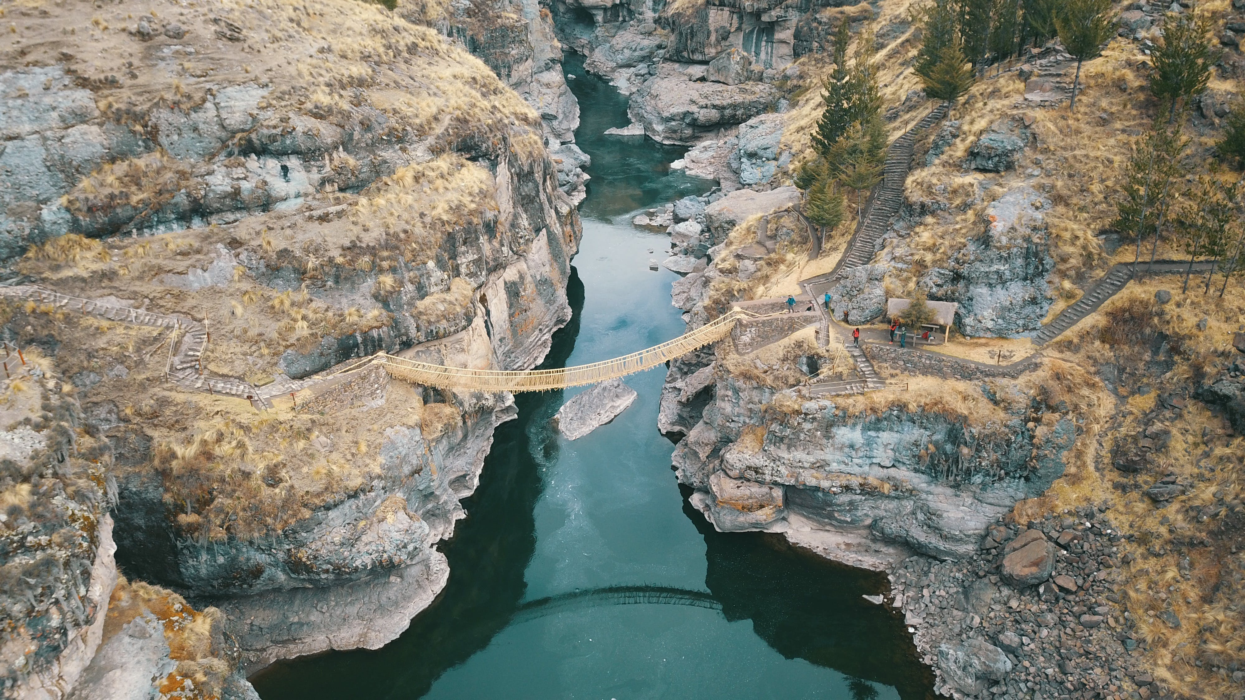 Aerial Photography of Brown Hanging Bridge Connecting Two Cliffs