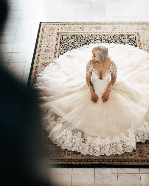 Woman Wearing White Sweetheart Neckline Wedding Dress
