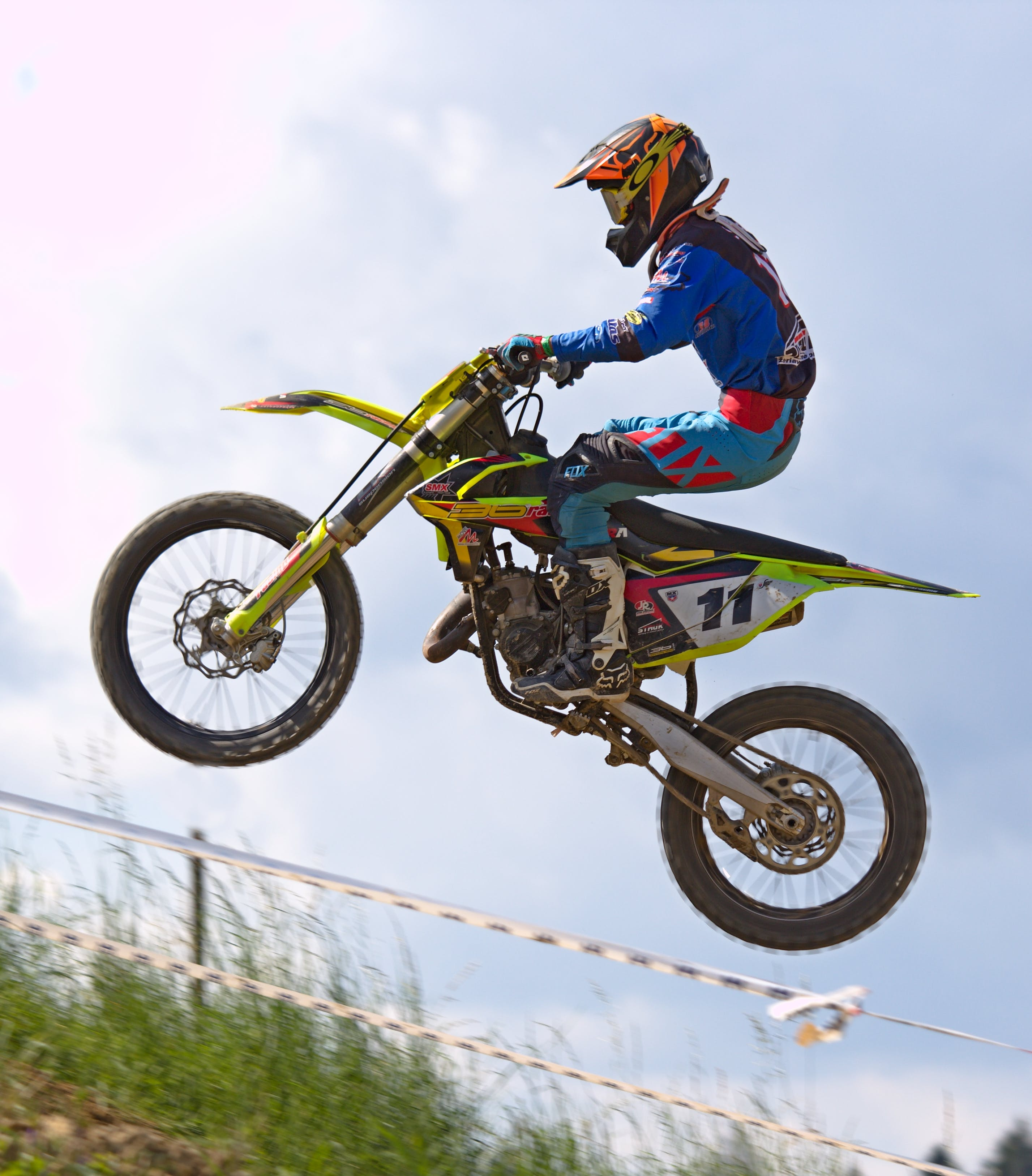 Person Doing Stunt in Motocross Dirt Bike