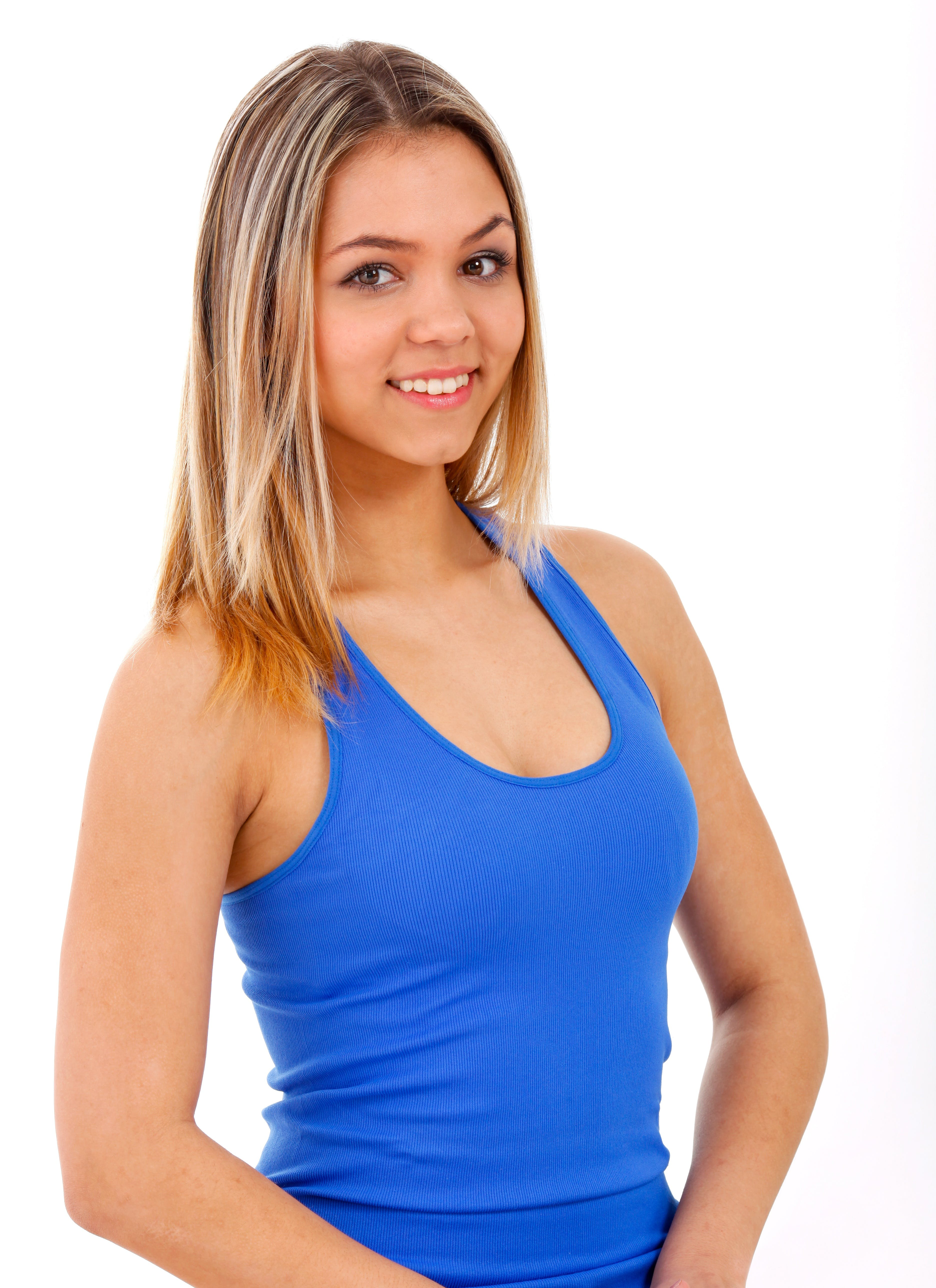 Woman Smiling While Wearing Blue Tank Top