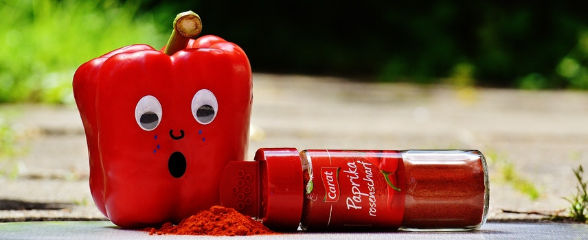 Red Pepper Beside Red Paprika Plastic Bottle