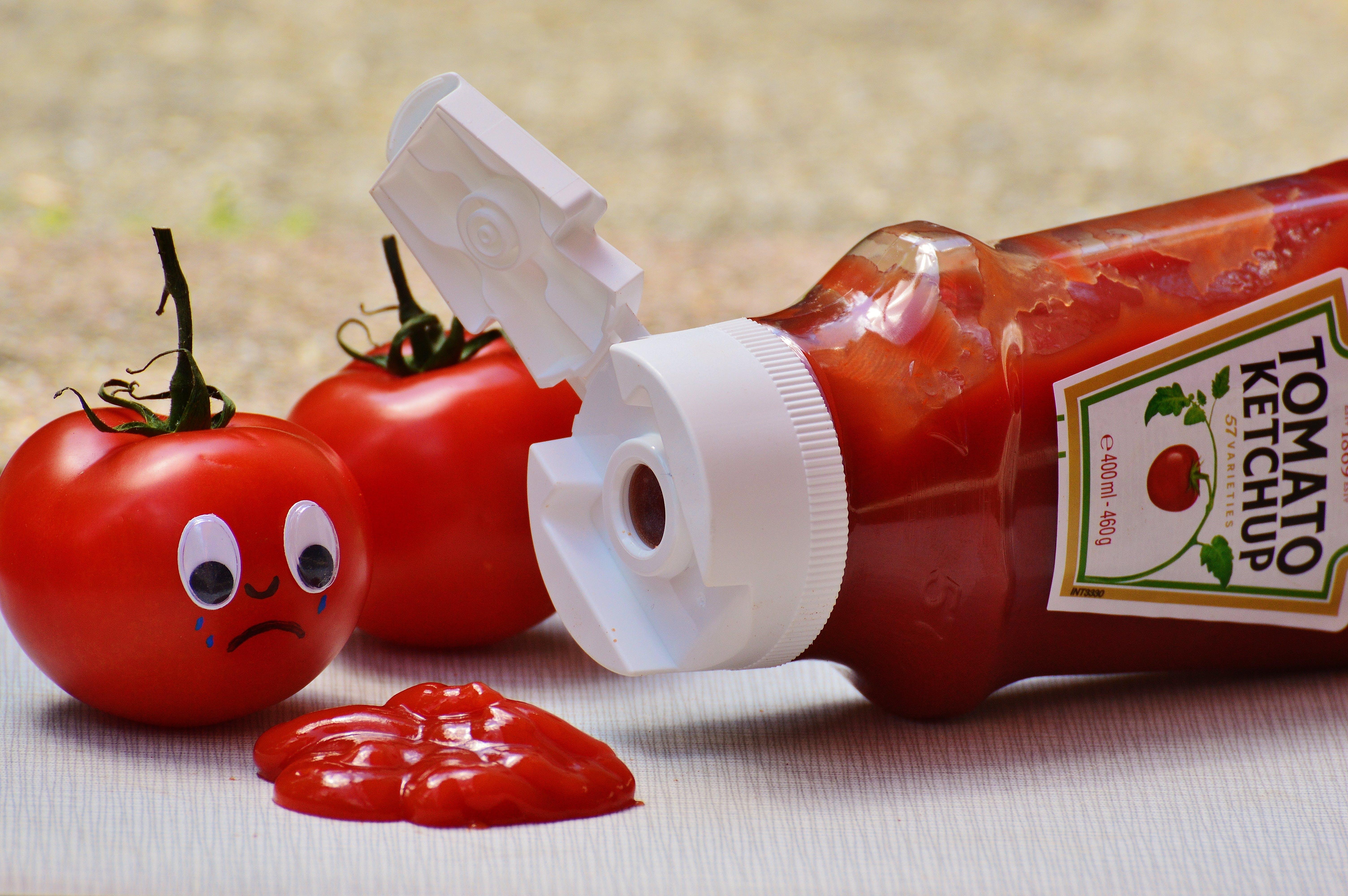 2 Tomatoes Beside Tomato Ketchup Ketchup