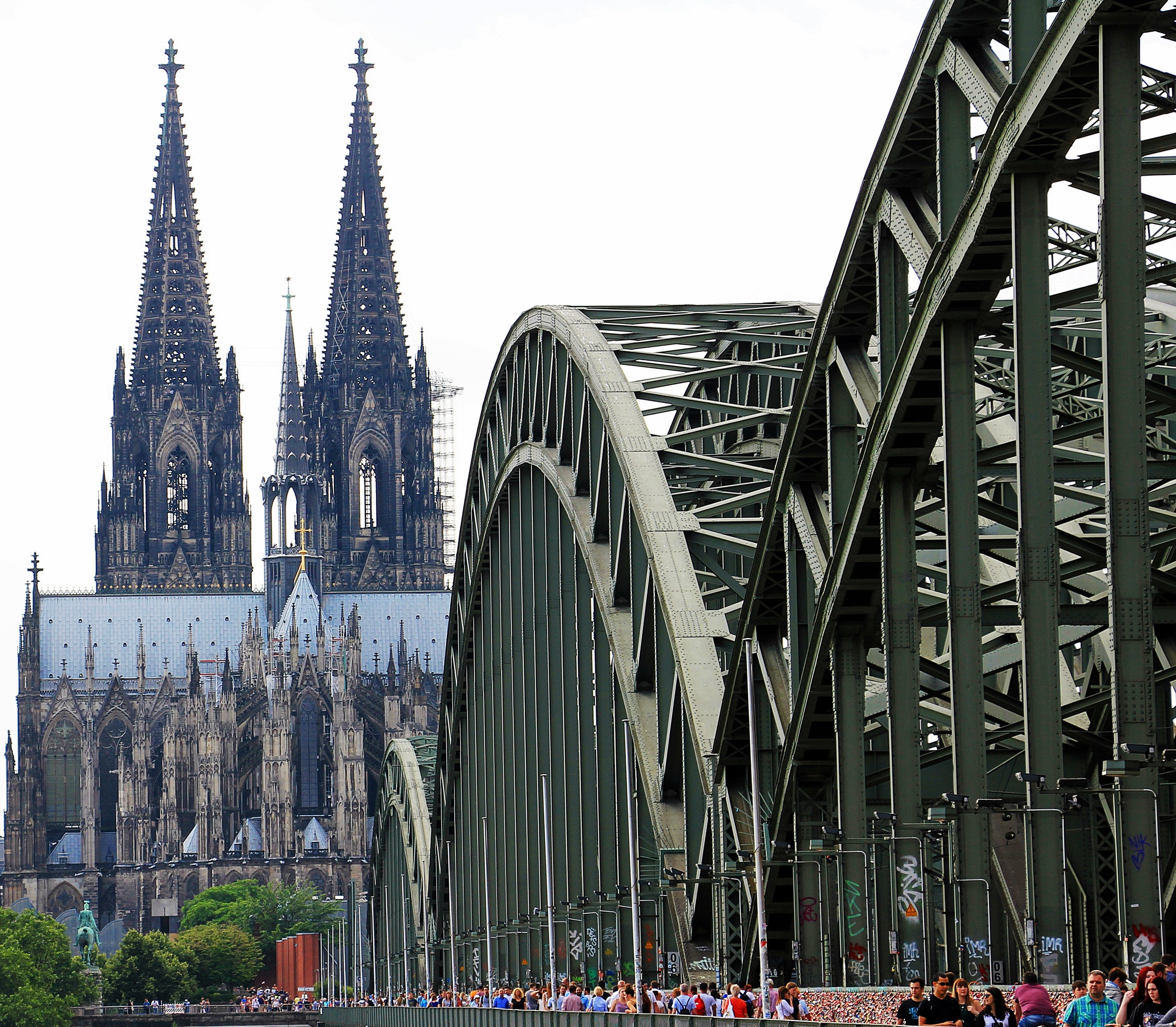 People Walling on Cologne Bridge Near Cologne Cathedral during Daytime