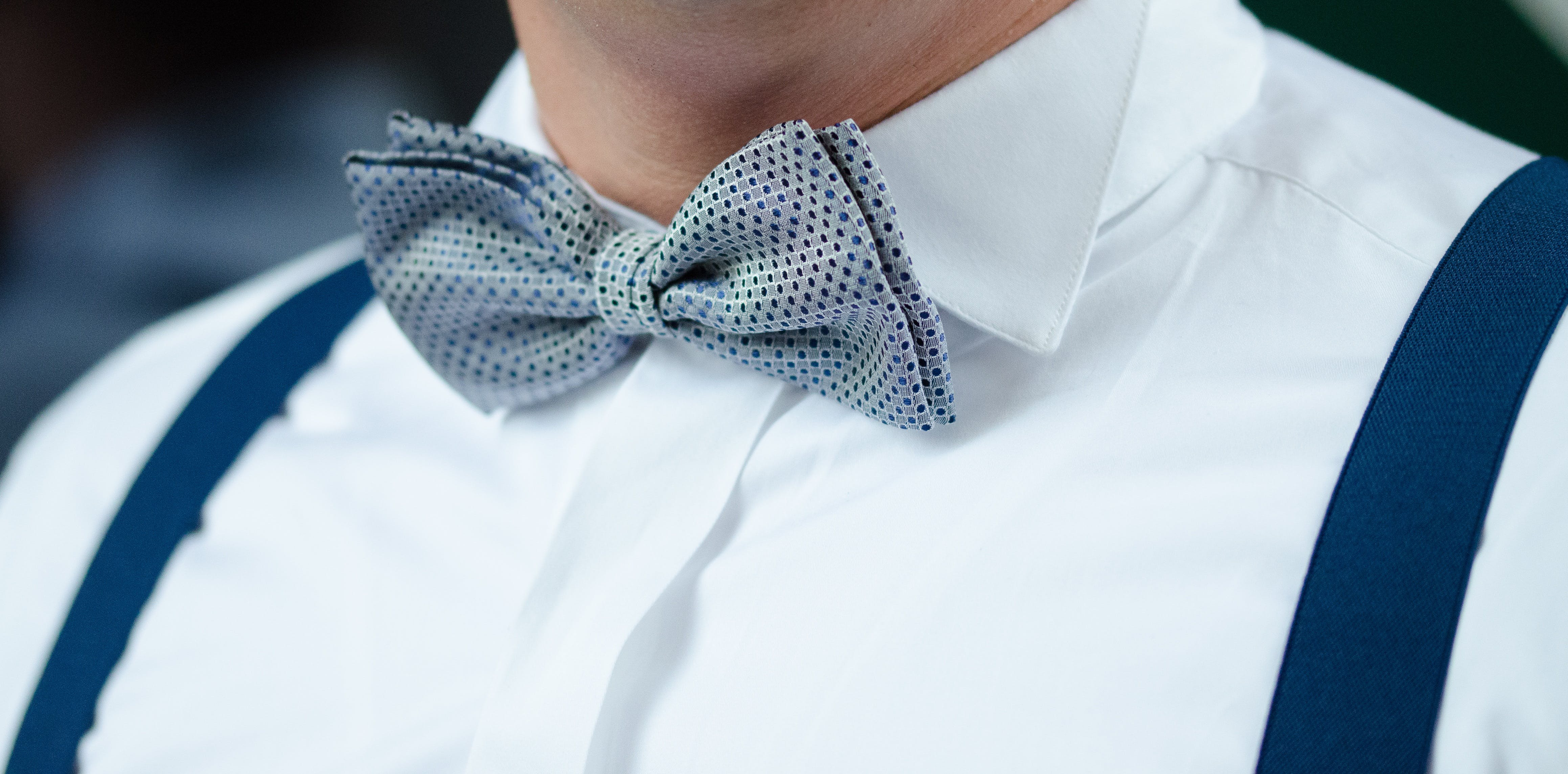 Man in White Dress Shirt Blue Suspenders and Gray Polka Dotted Bowtie