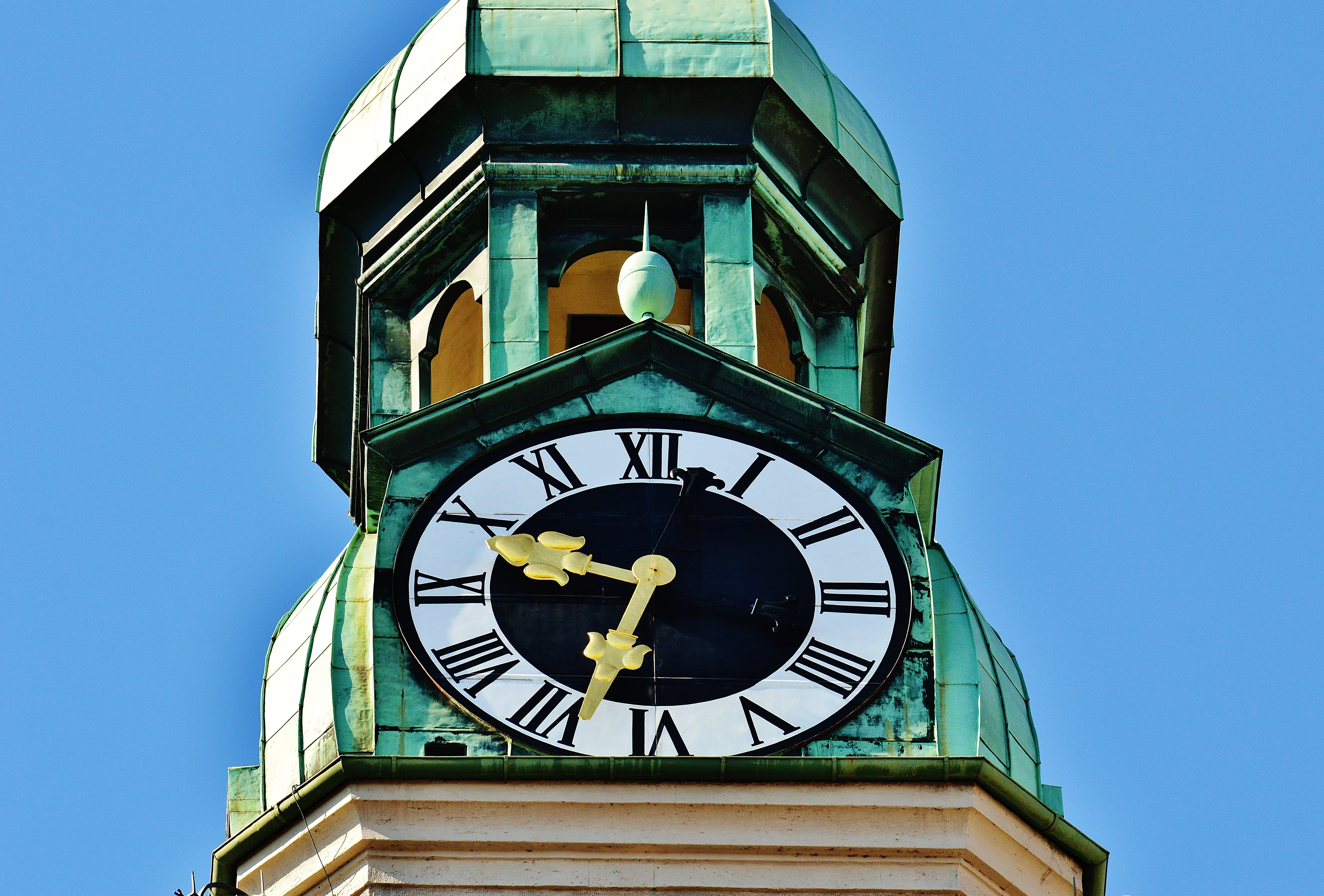 Tower Clock Under Blue Sky during Daytime