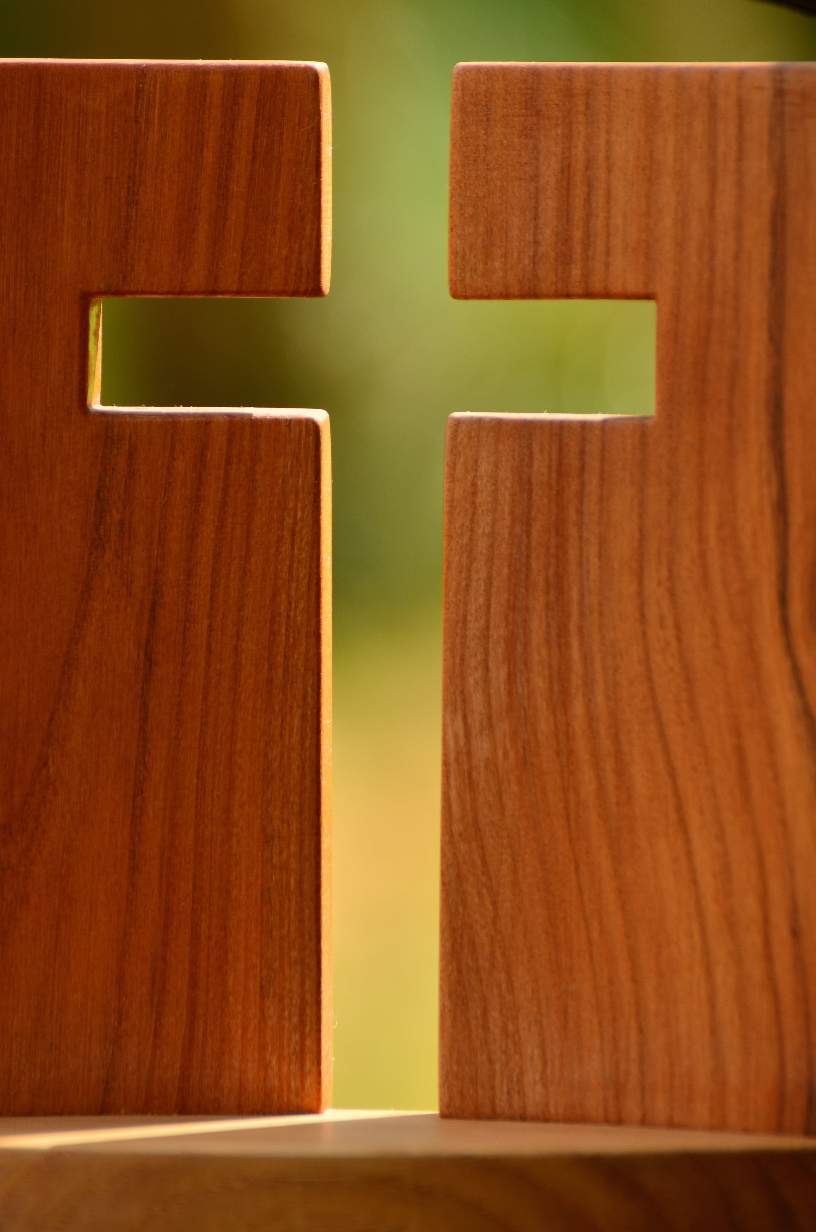 2 Brown Wooden Boards Forming Cross