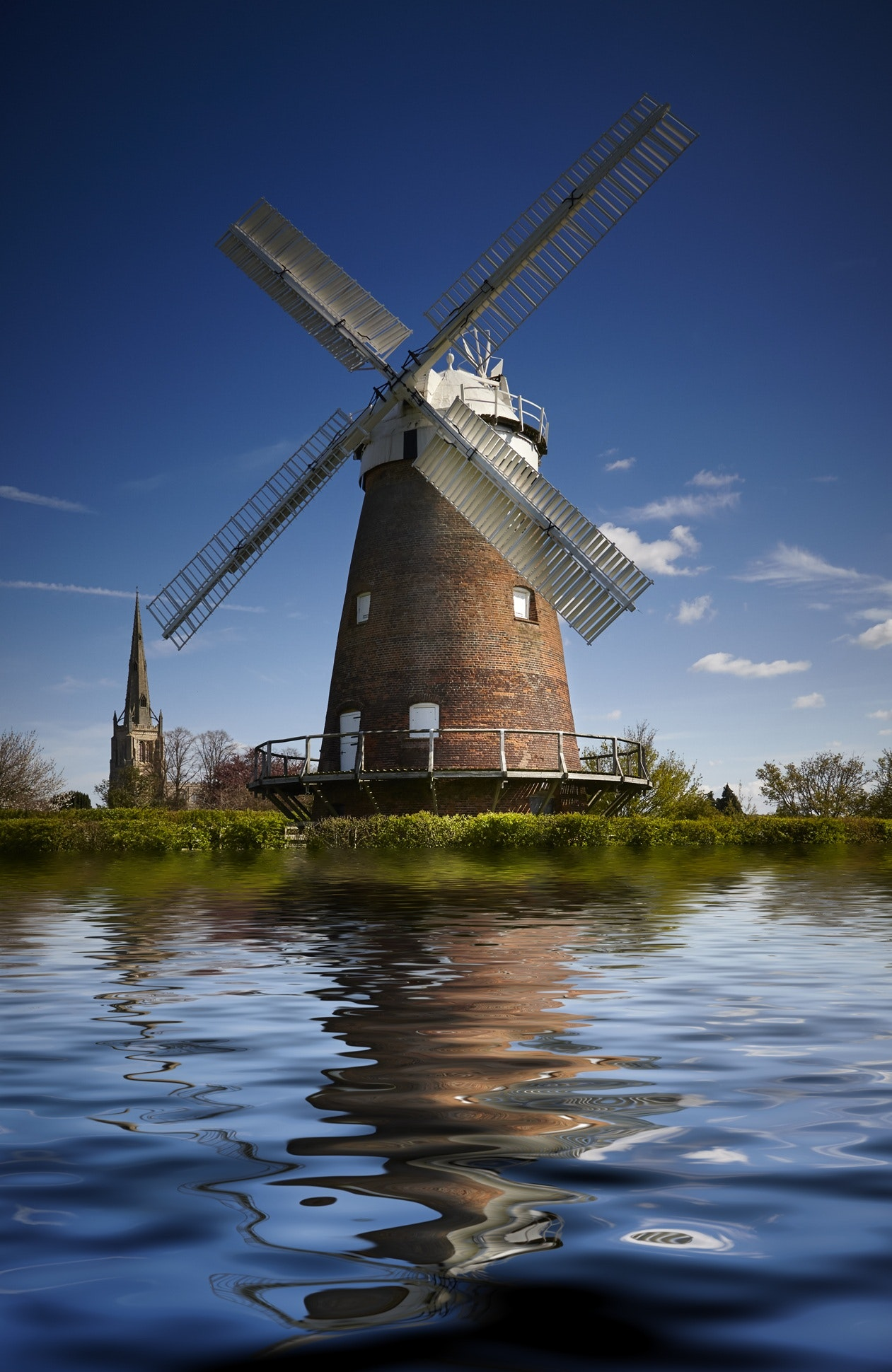 photography of windmill under blue sky during daytime free stock photo