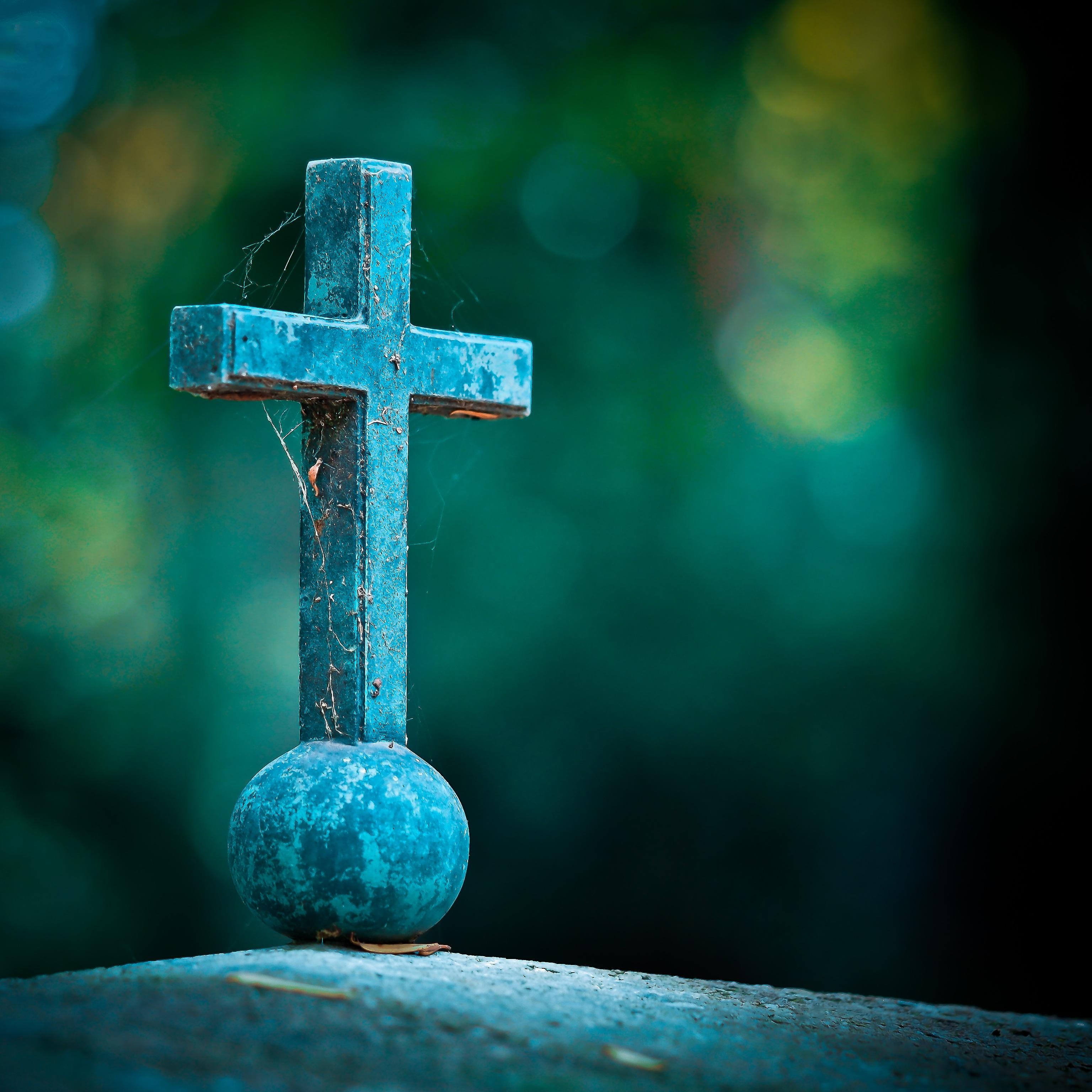 Selective Photo of Teal Cross Decor