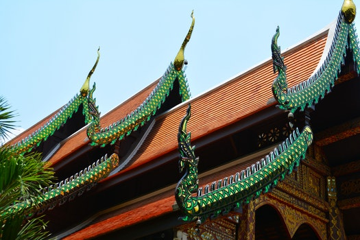 Worms Eye View of Green and Orange Temple