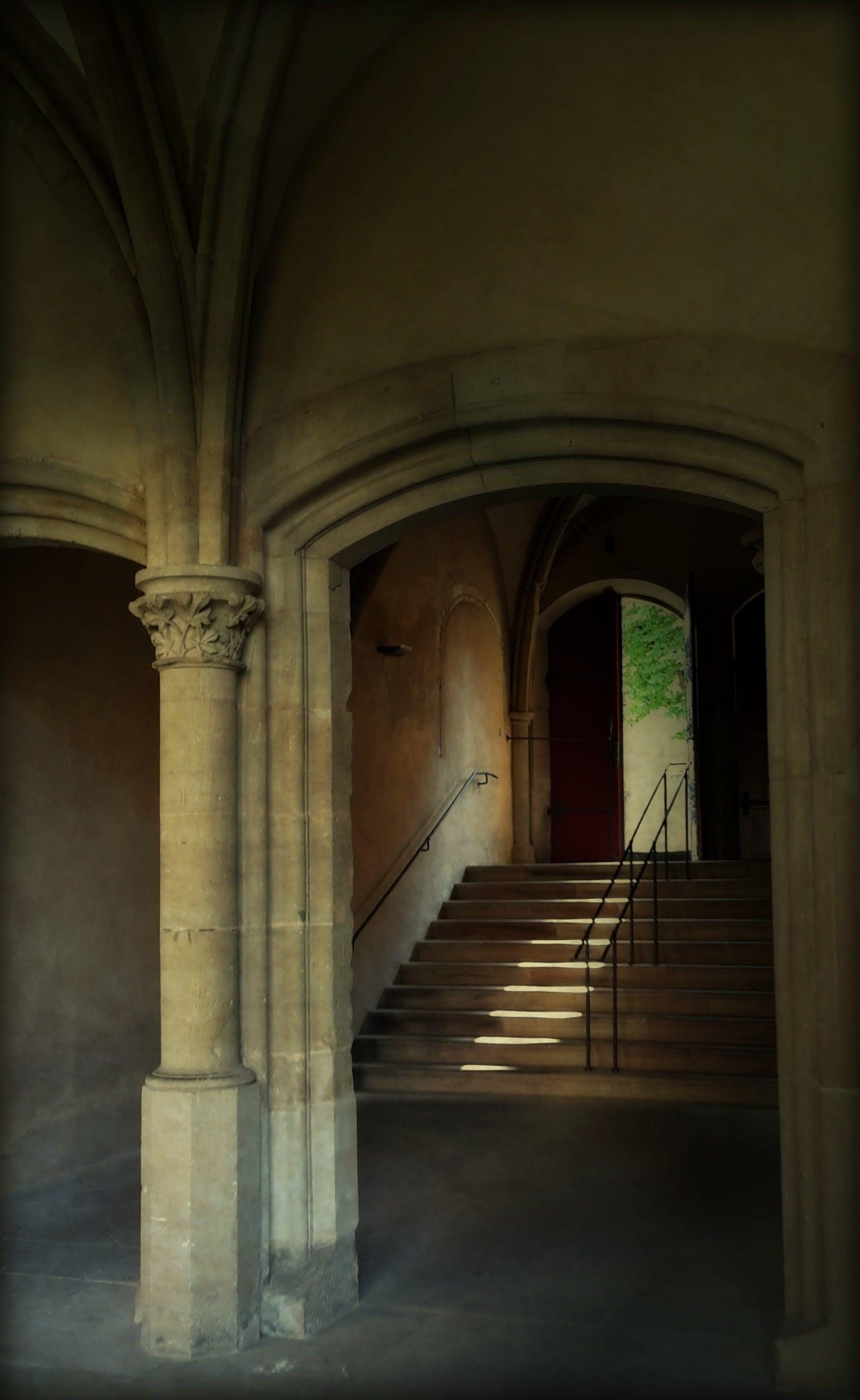 Beige Stone Stairway by Brown Door