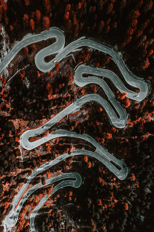 從上面, 曲折, 空中拍攝, 路 的 免费素材照片