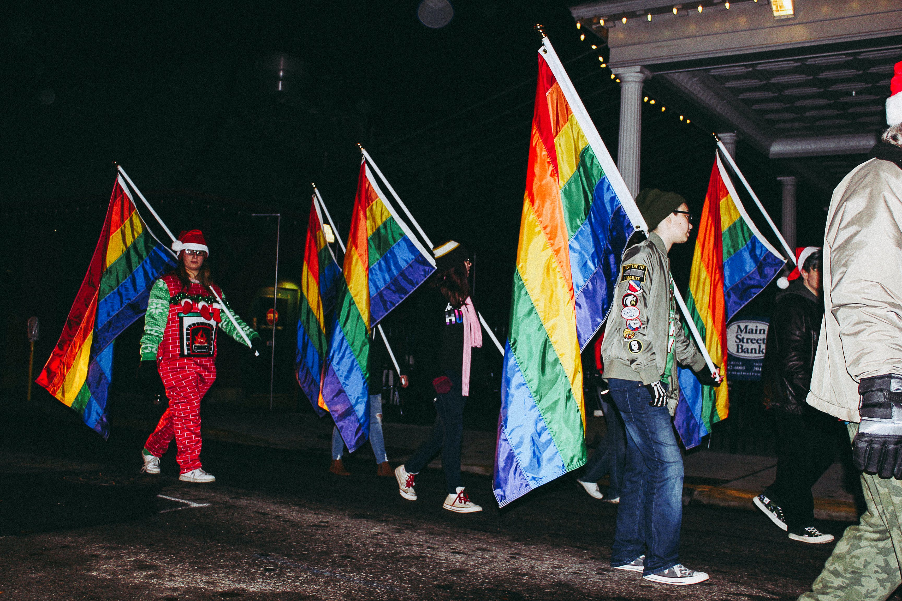 People Carrying Flags during Nighttime