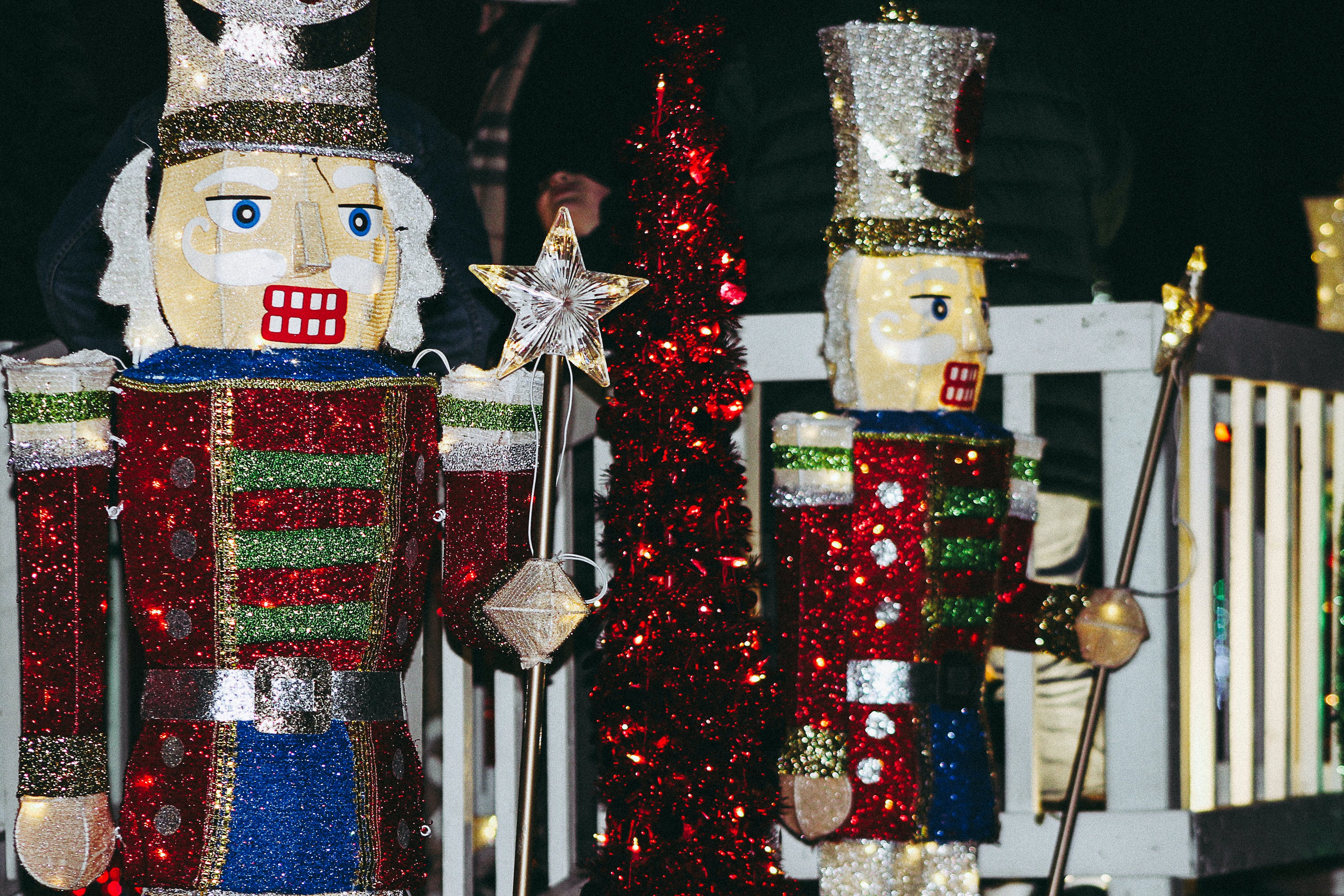 Two Nutcracker Figurine Near Fence