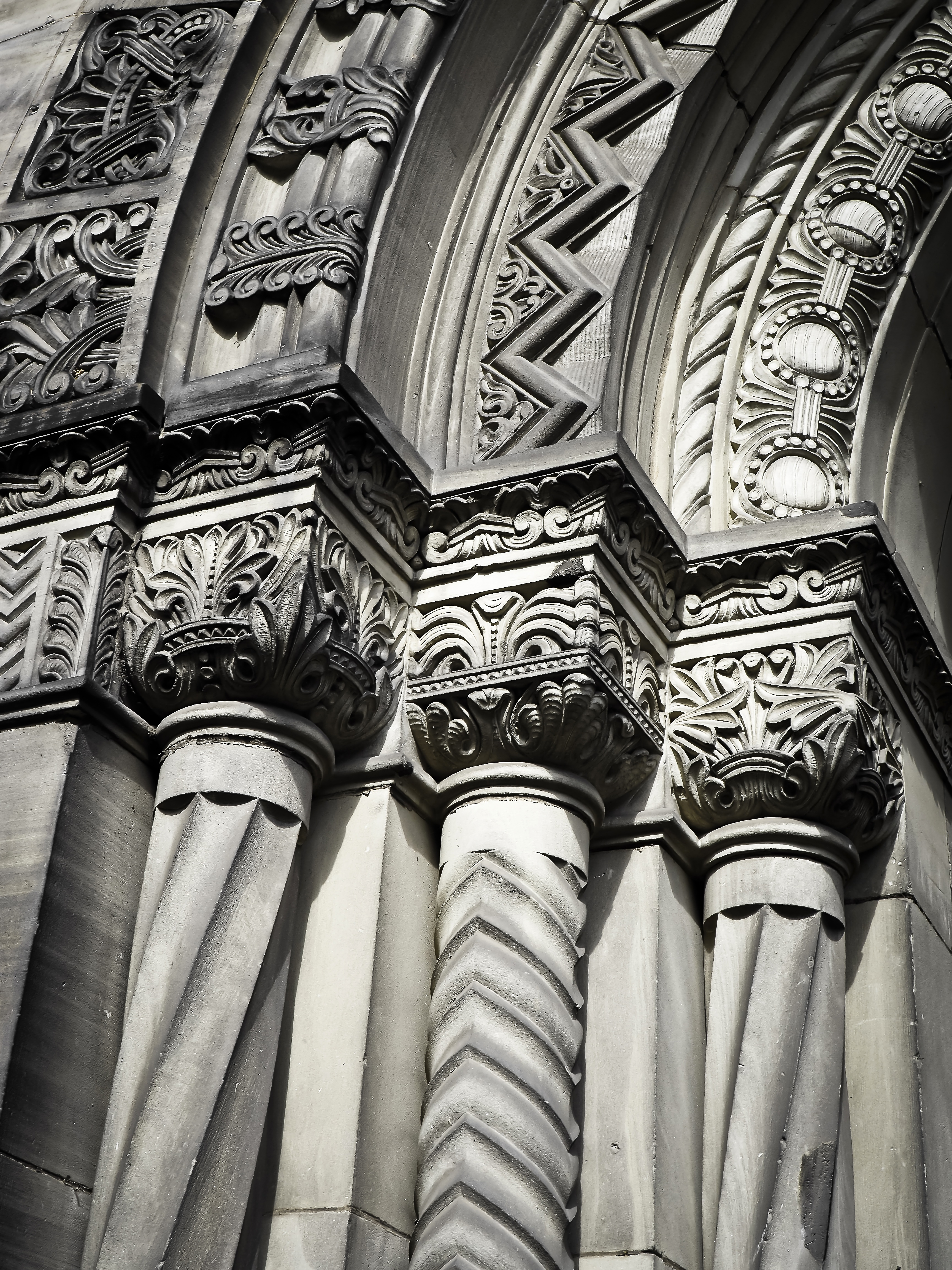 Grayscale Photo of Concrete Building With Pillars