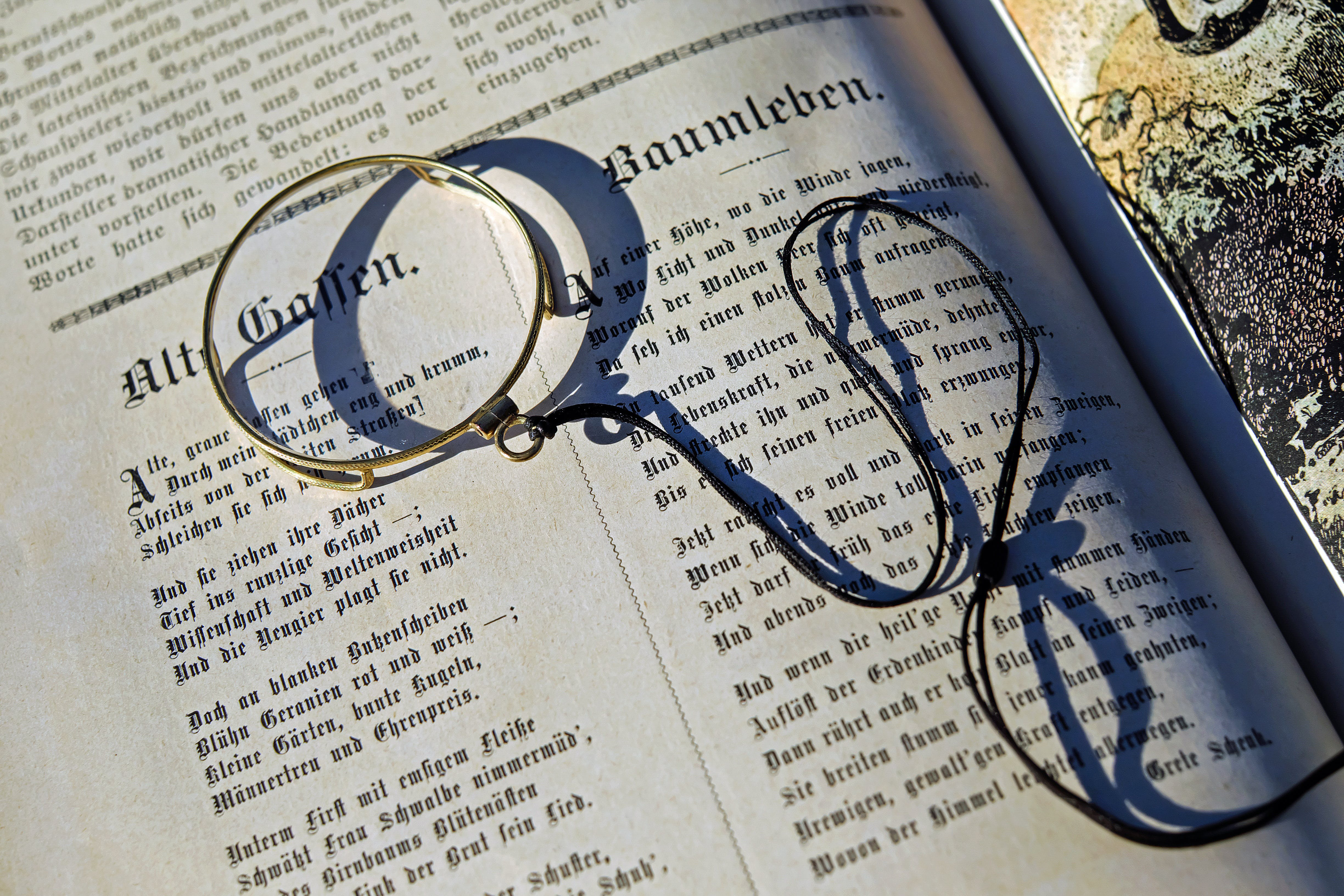 Black String on Top of an Open Book during Daytime