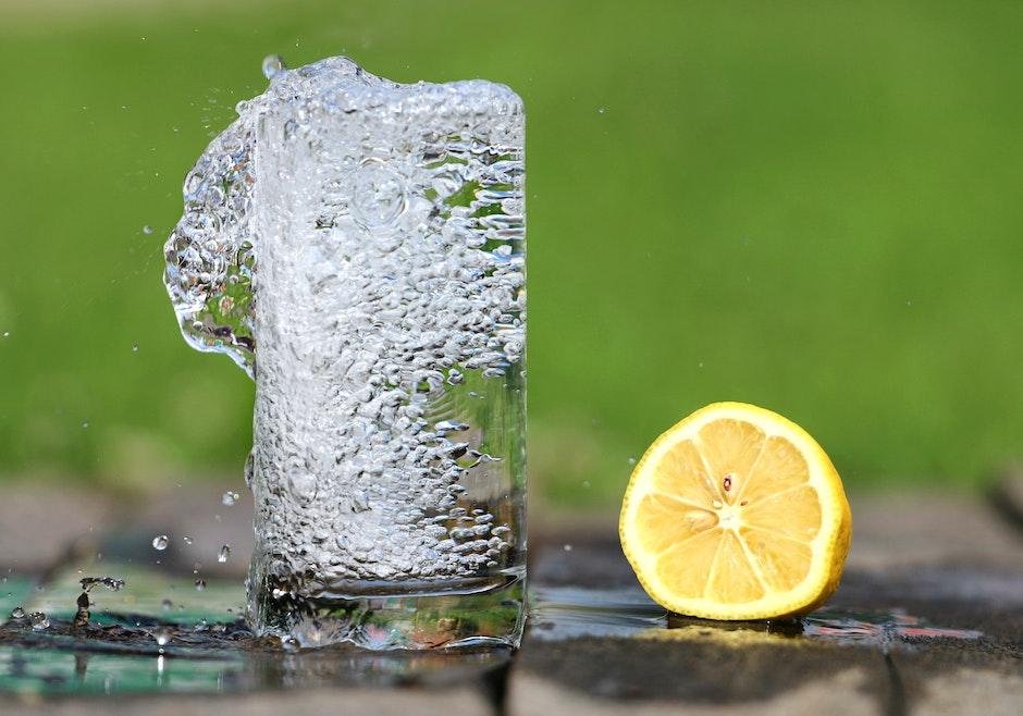 Time Lapse Photography of Water Bobbling Beside Lemon Fruit