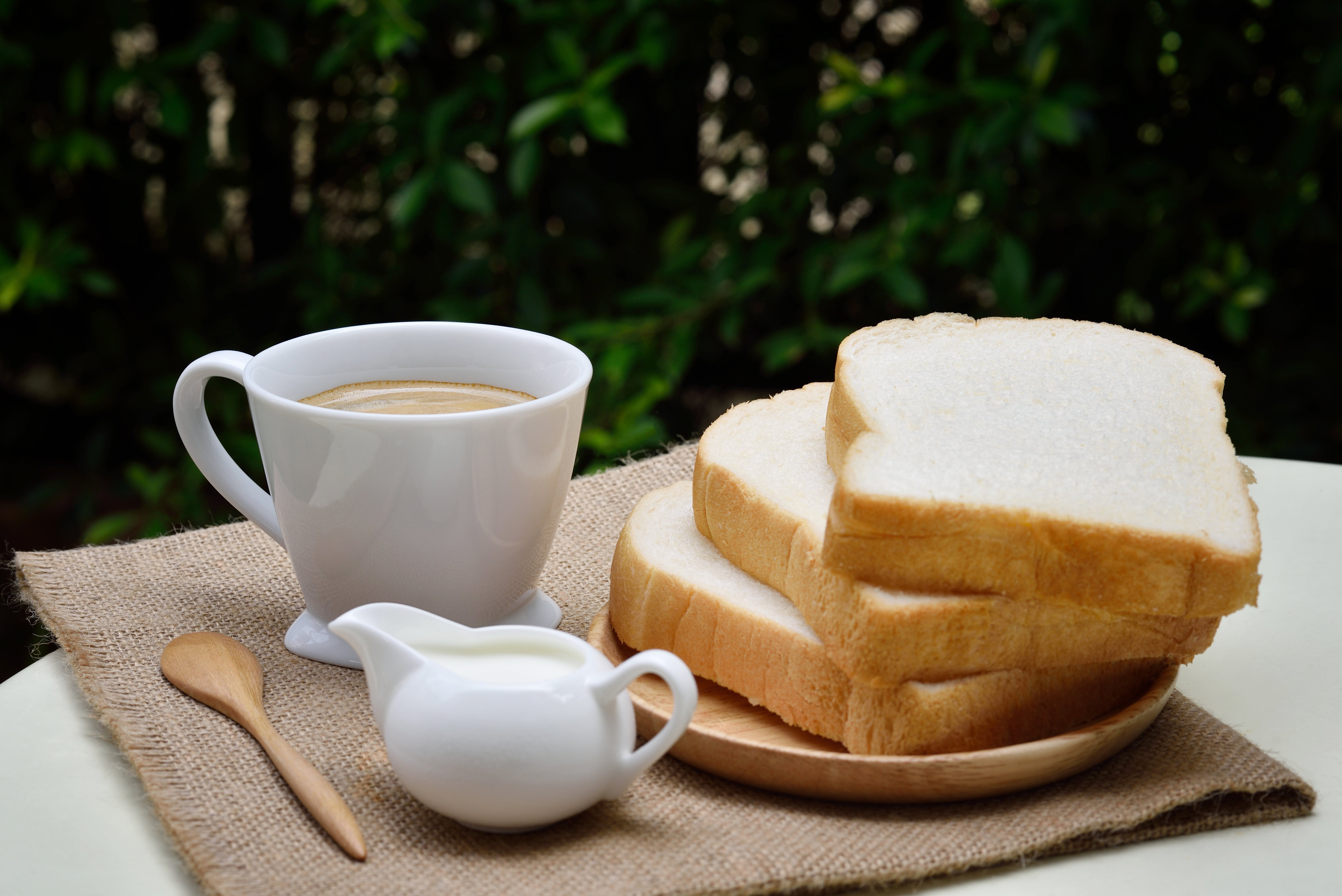 3 Sliced Loafs Beside White Ceramic Coffee Cup