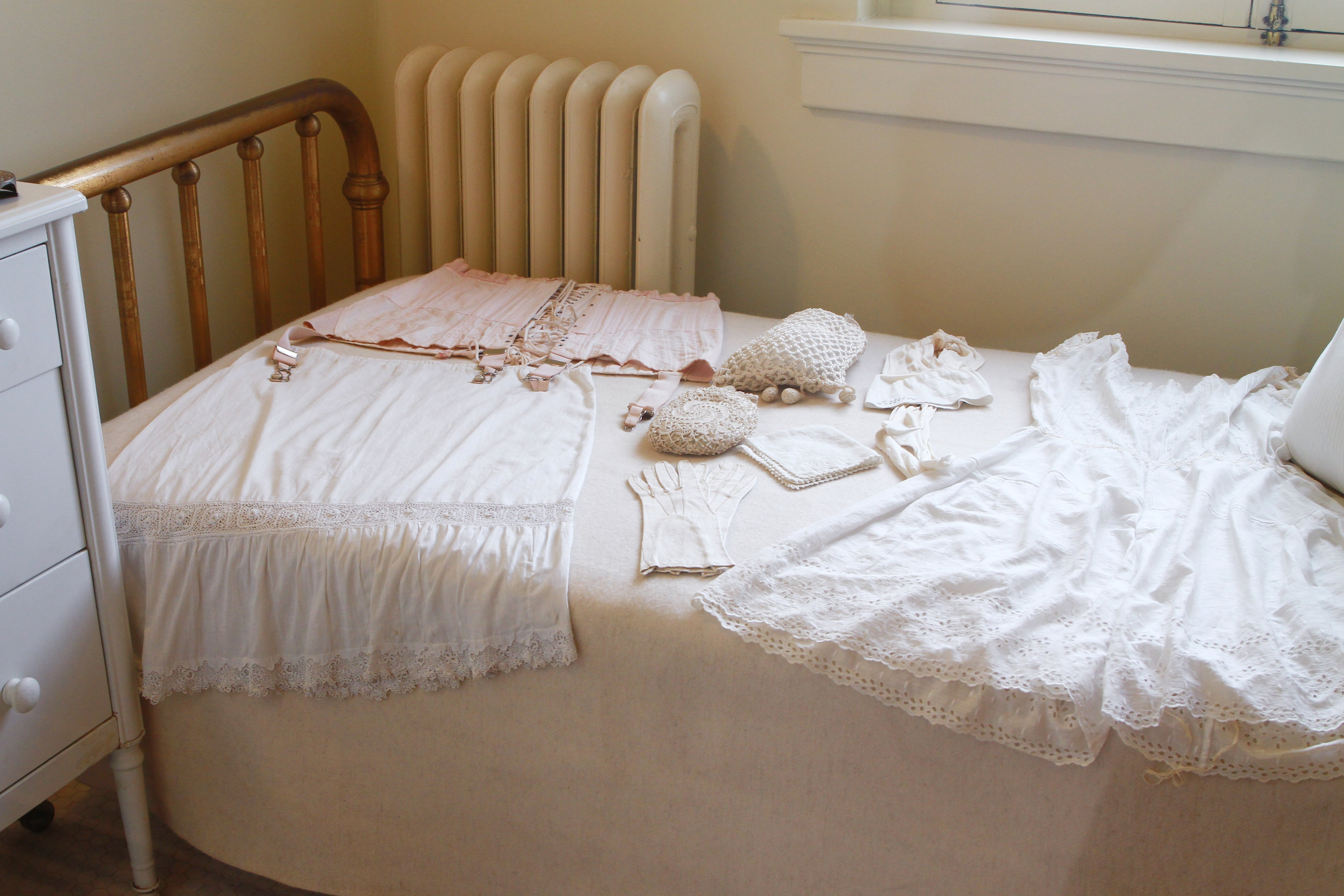 White Sleeveless Dress on White Mattress